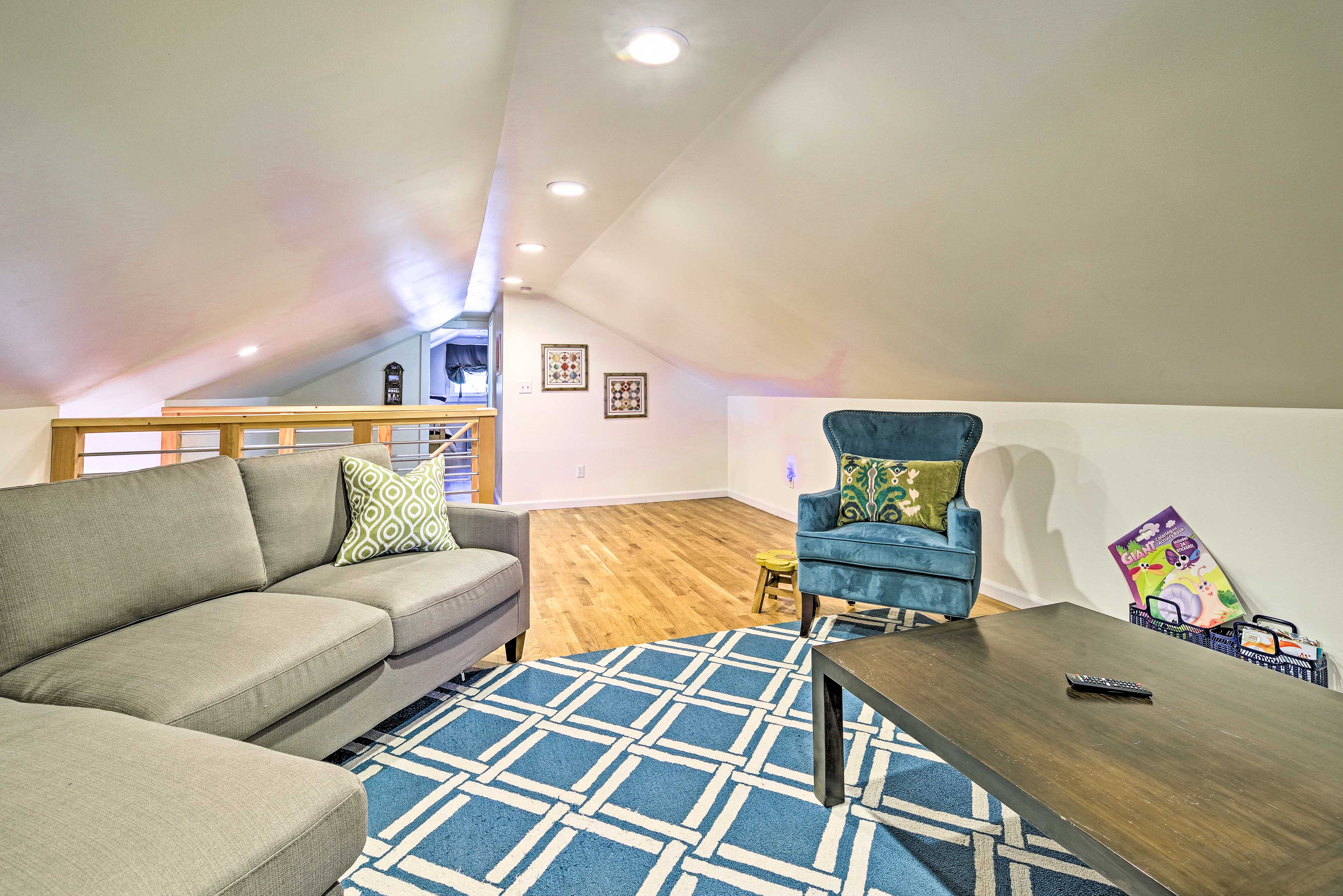 Head upstairs to find the loft complete with a Smart TV.