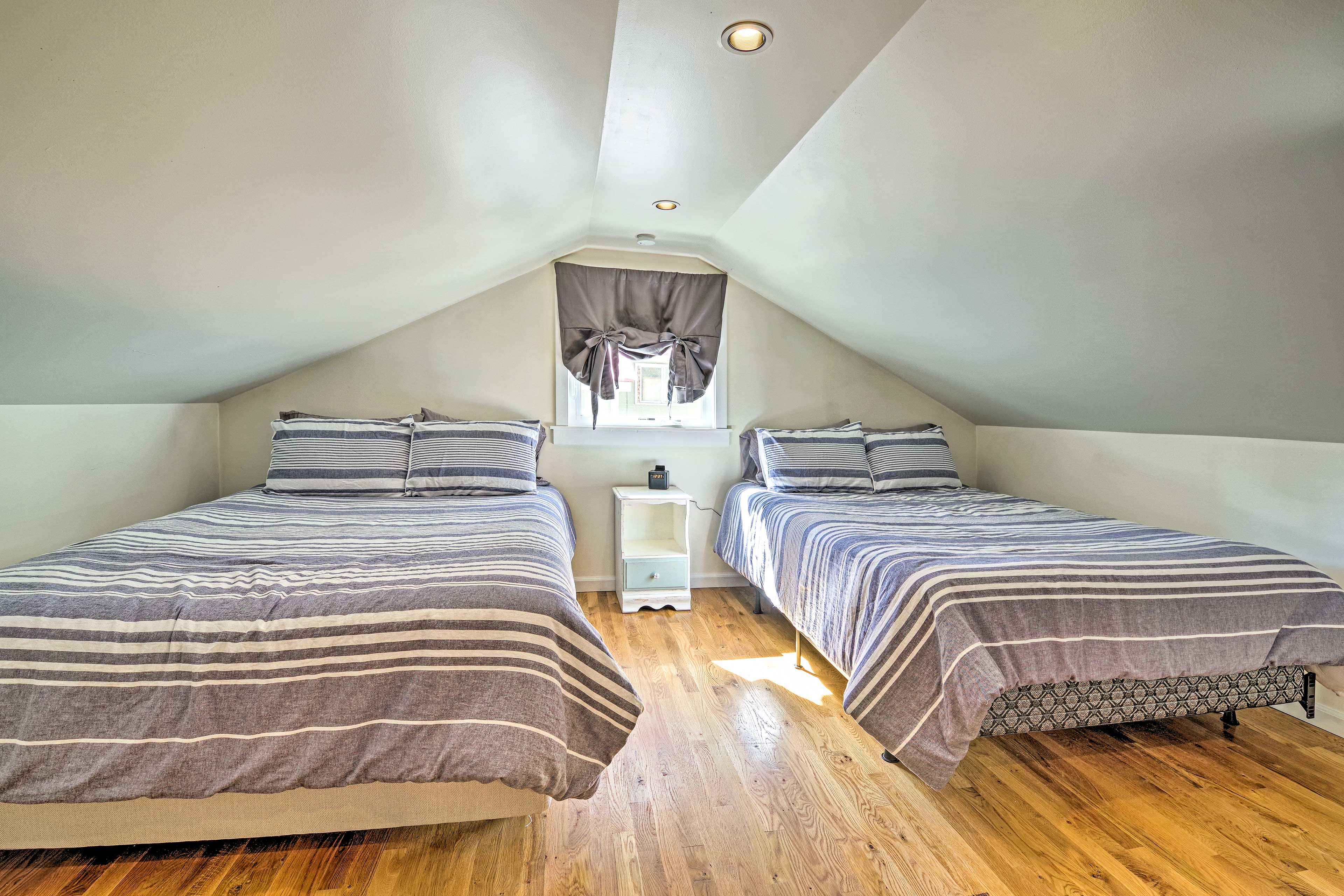 The fourth bedroom is equipped with 2 queen beds.
