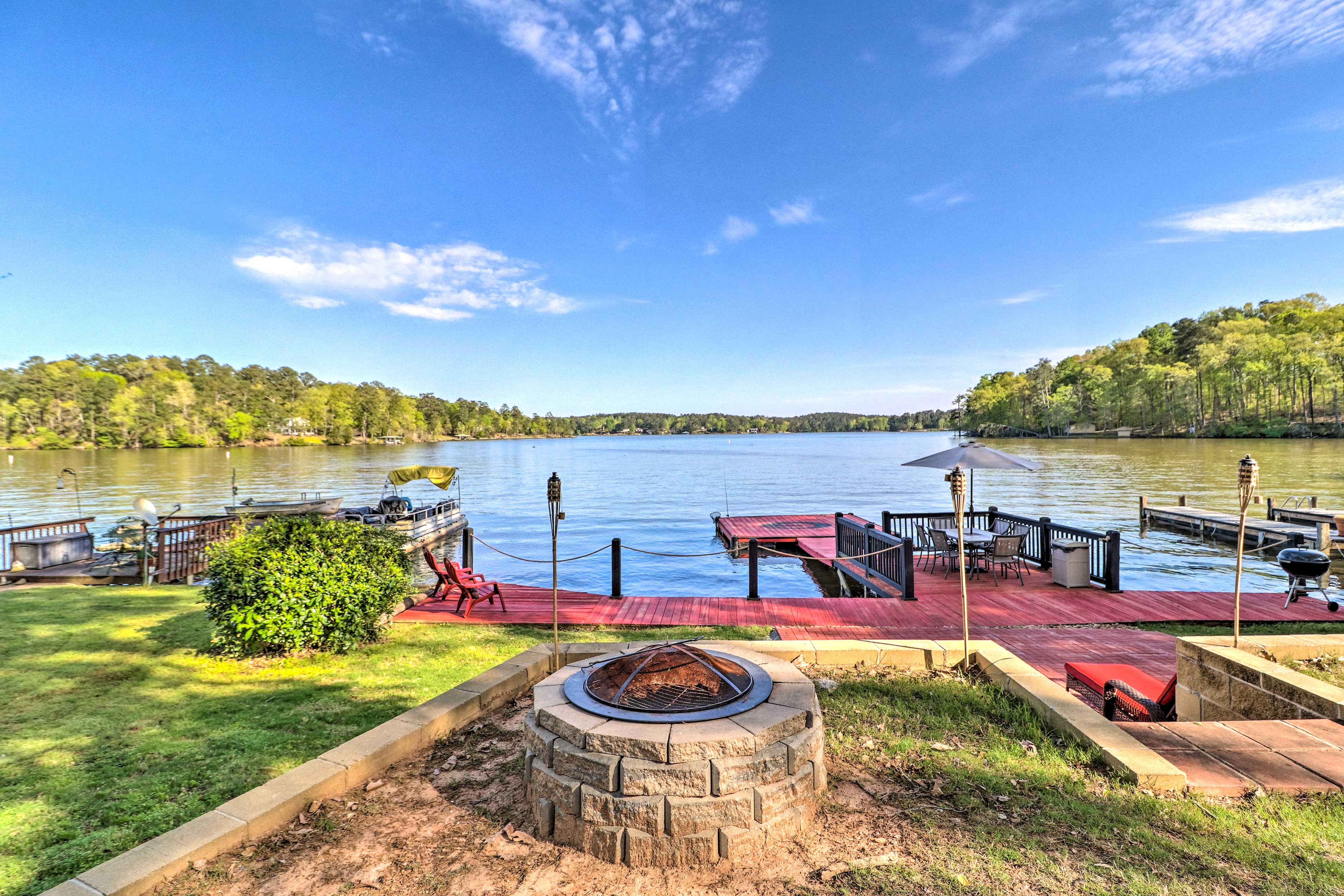 This Jackson home invites you to spend time outdoors with a fire pit and deck!