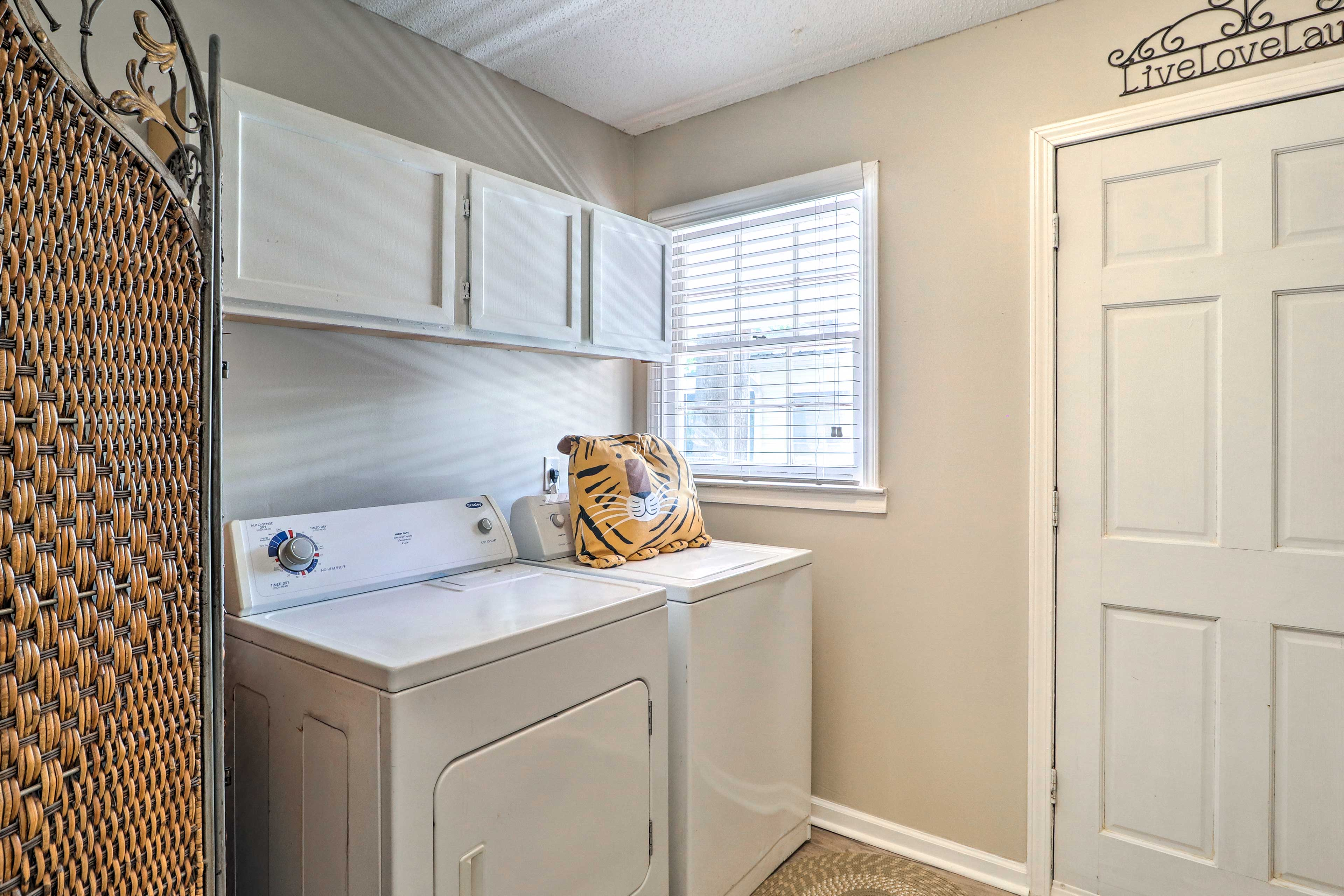 A laundry room adds a convenient touch to your stay!