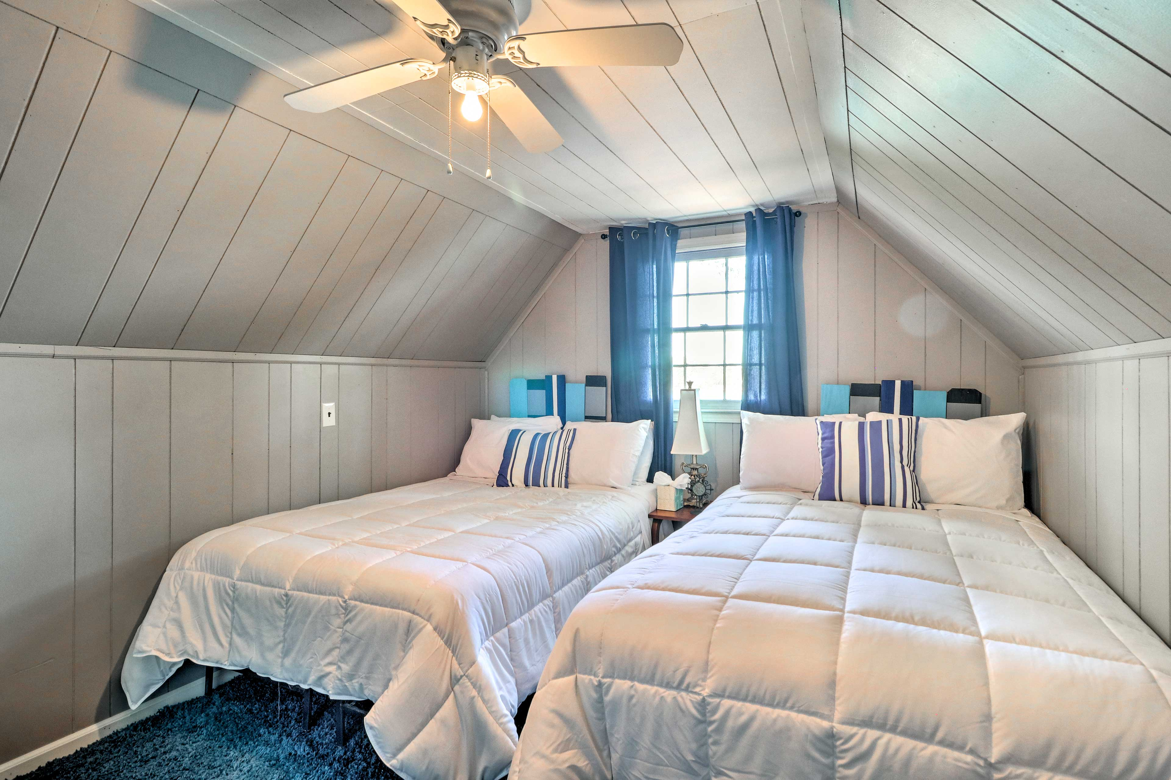 This bedroom calls for a sleepover with 2 full beds.