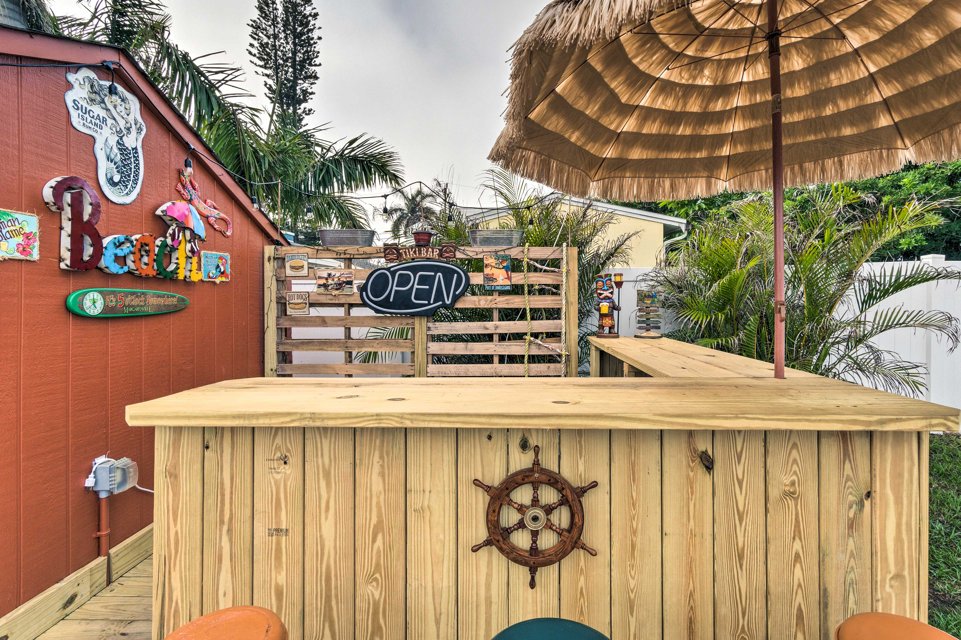 Serve up drinks from this awesome Tiki bar, day or night!