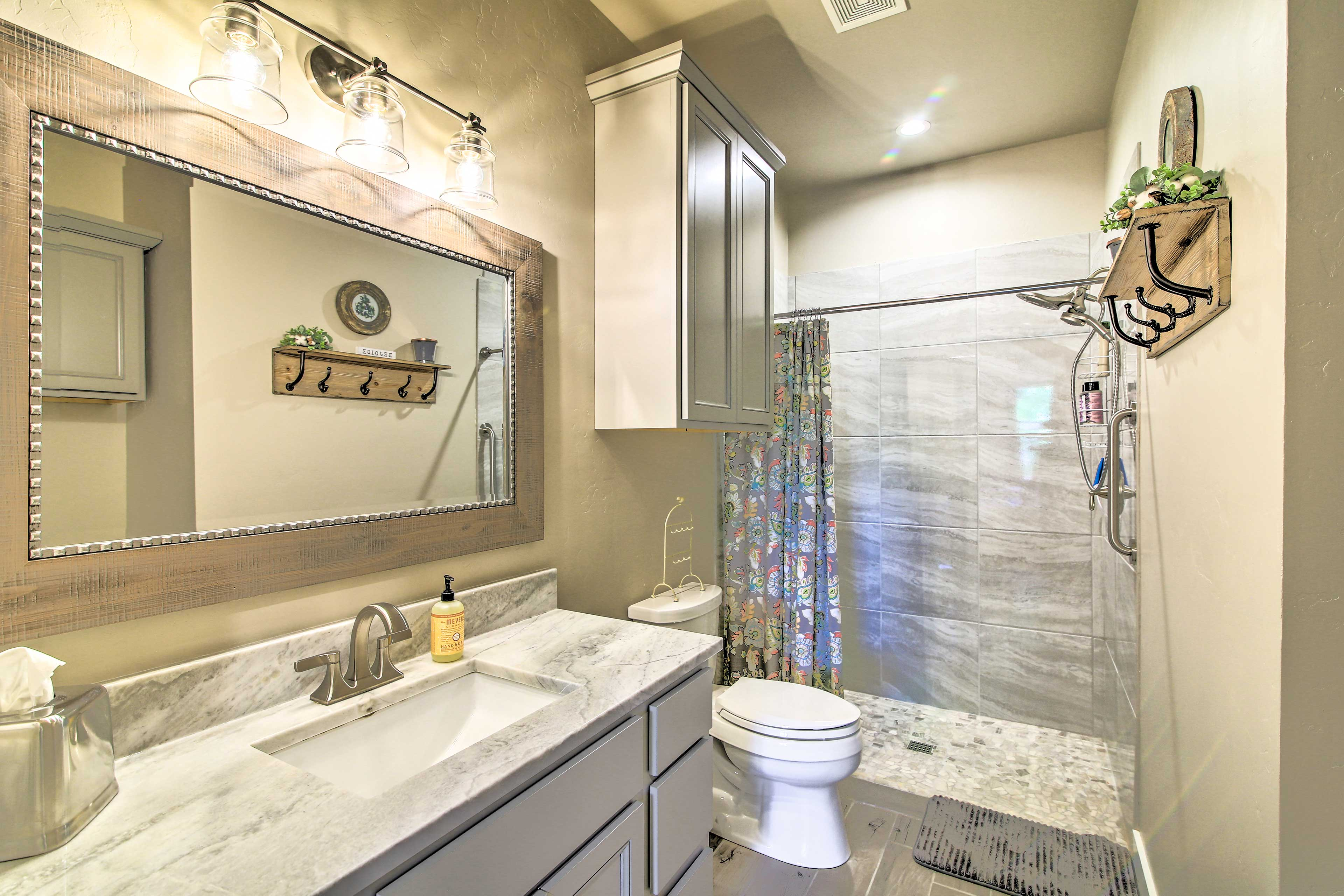 The luxurious bathroom boasts a step-in shower.