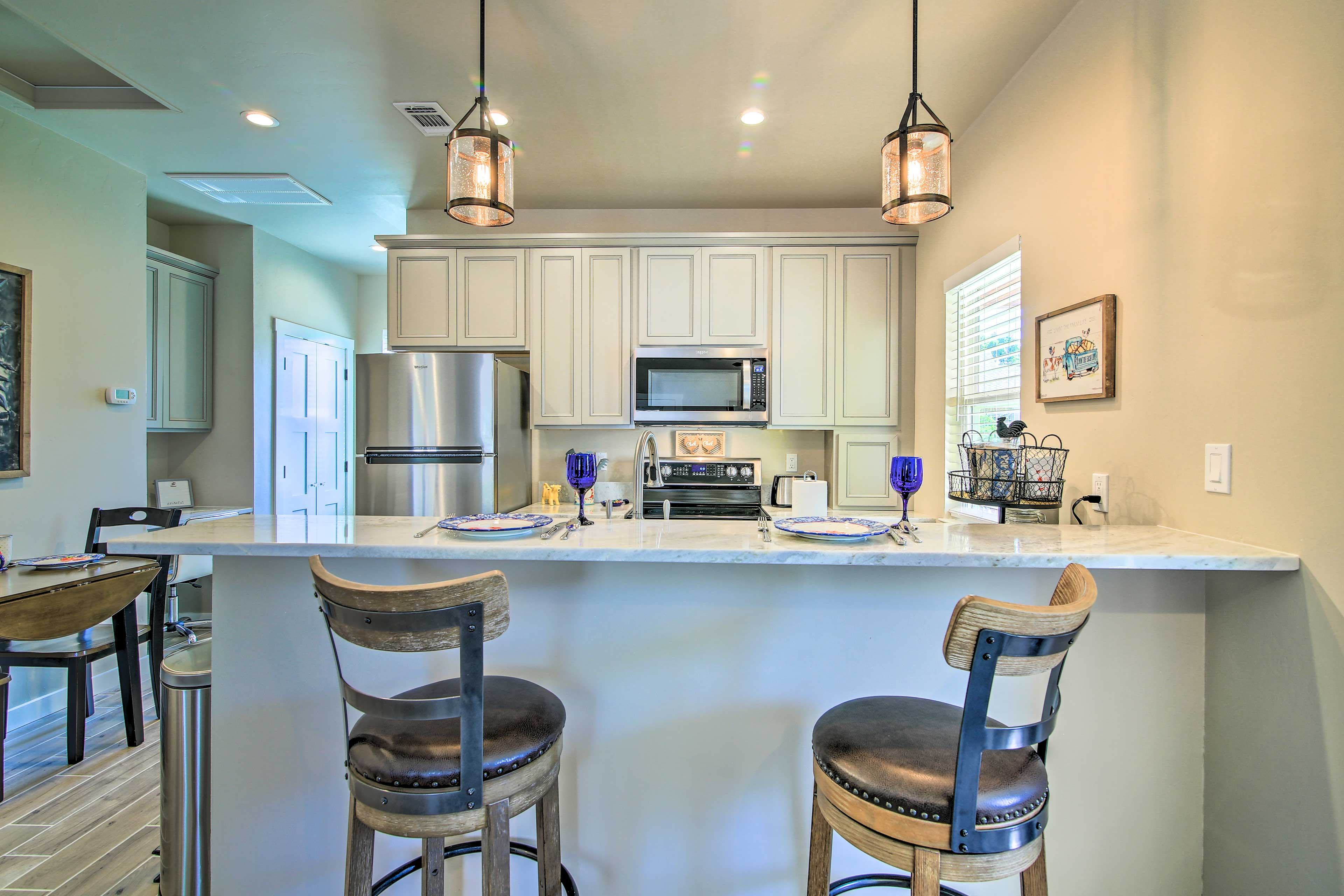 This vacation rental boasts a modern kitchen.