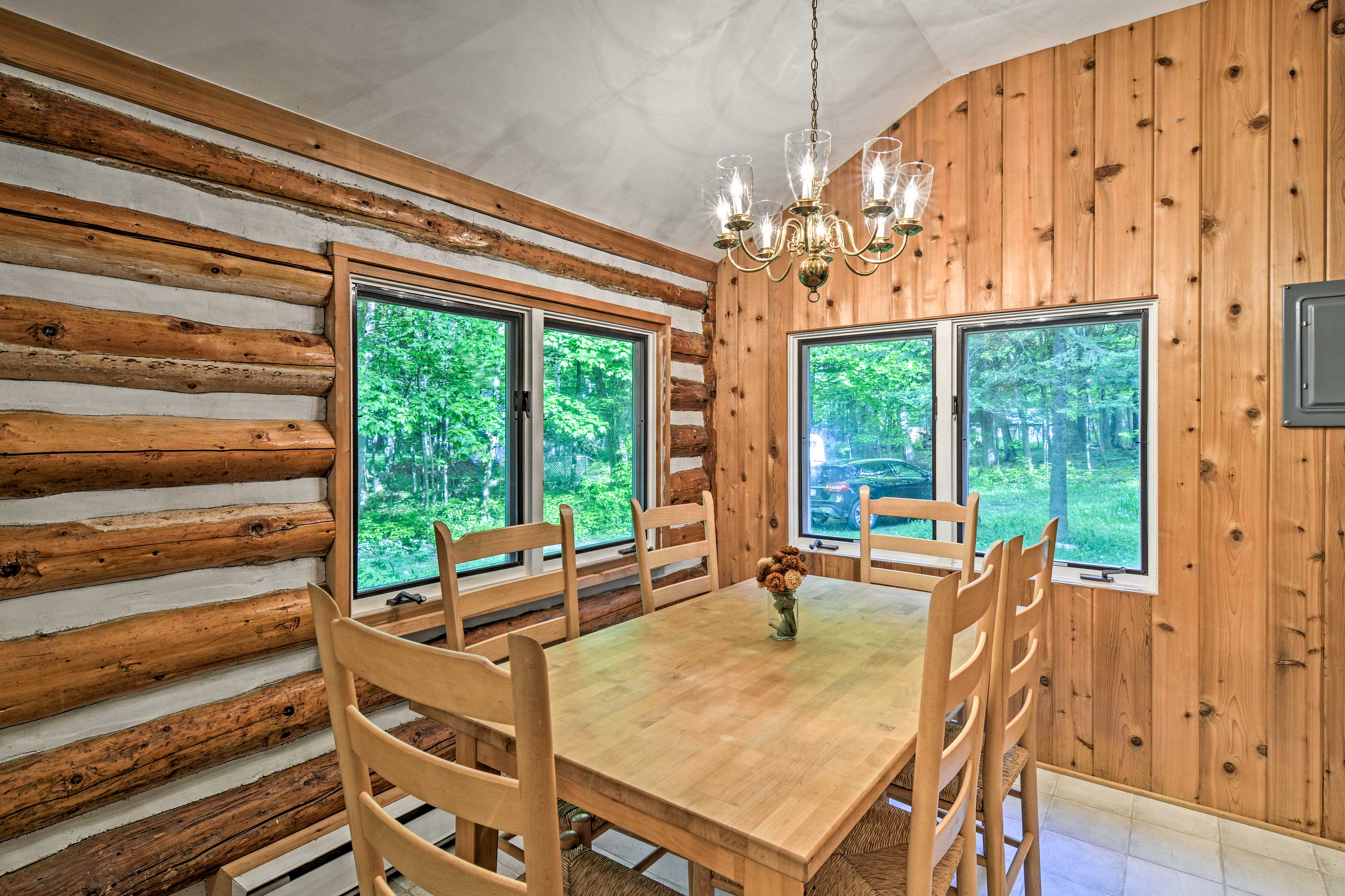 Enjoy meals shared around this wooden dining table.