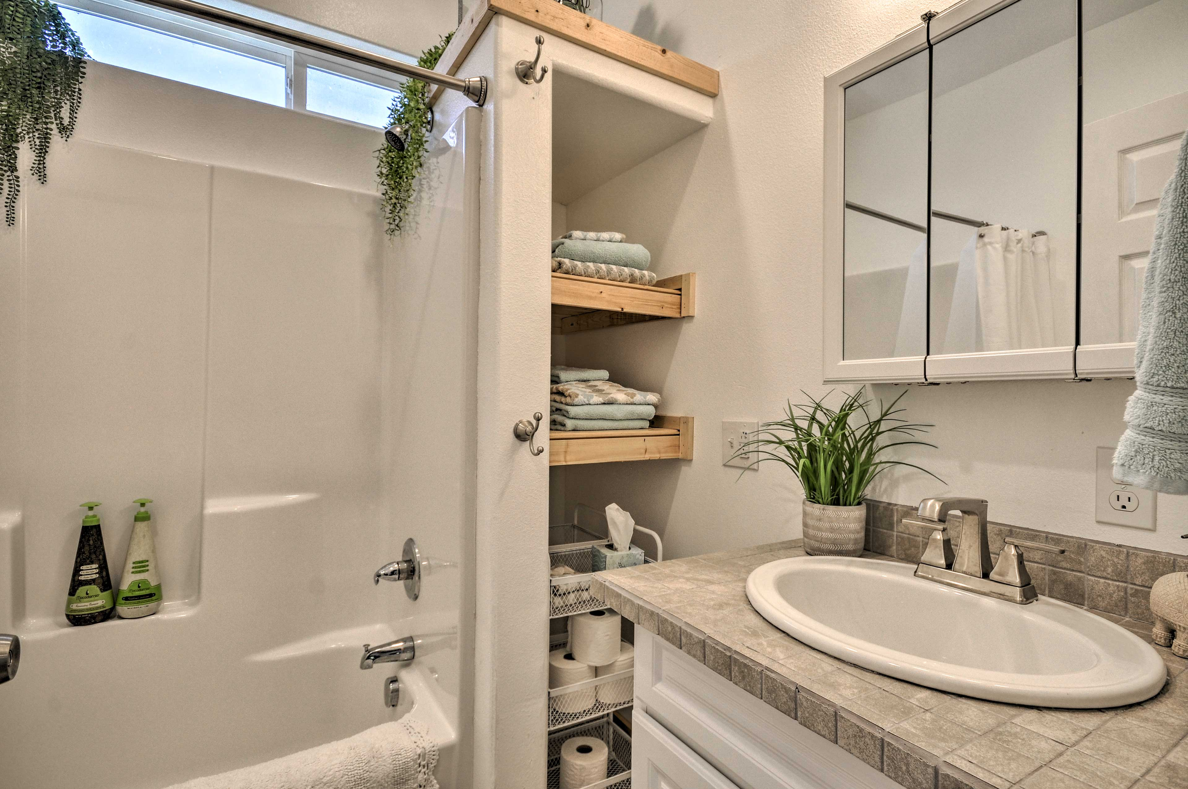 Open up the mirrors to store your toiletries with ease.
