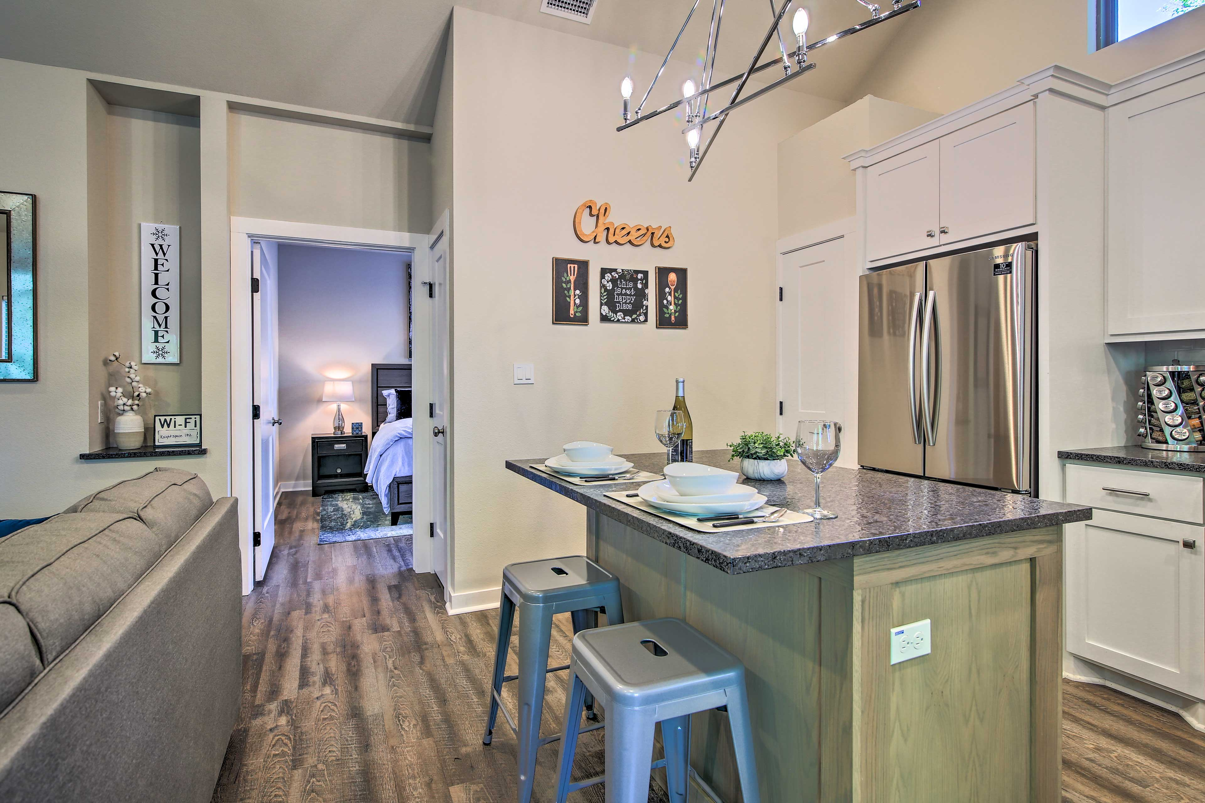 The full kitchen is outfitted with stainless steel appliances.