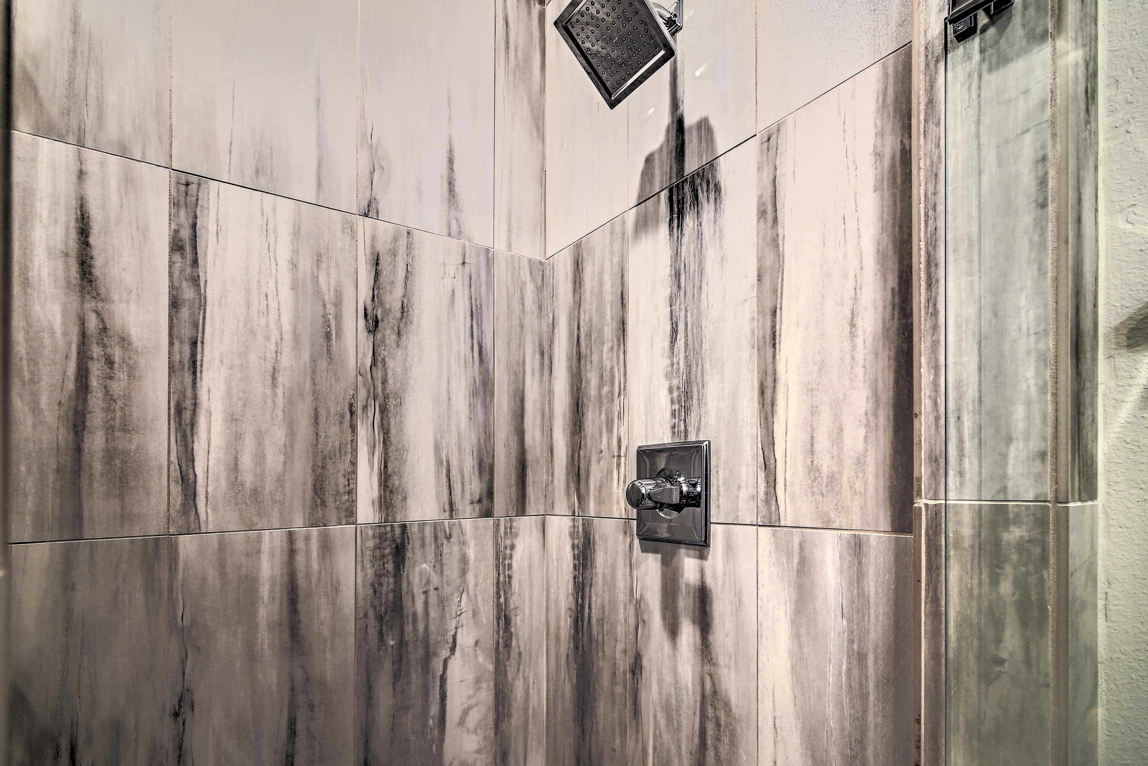 Rinse away the day in the tile-lined shower.