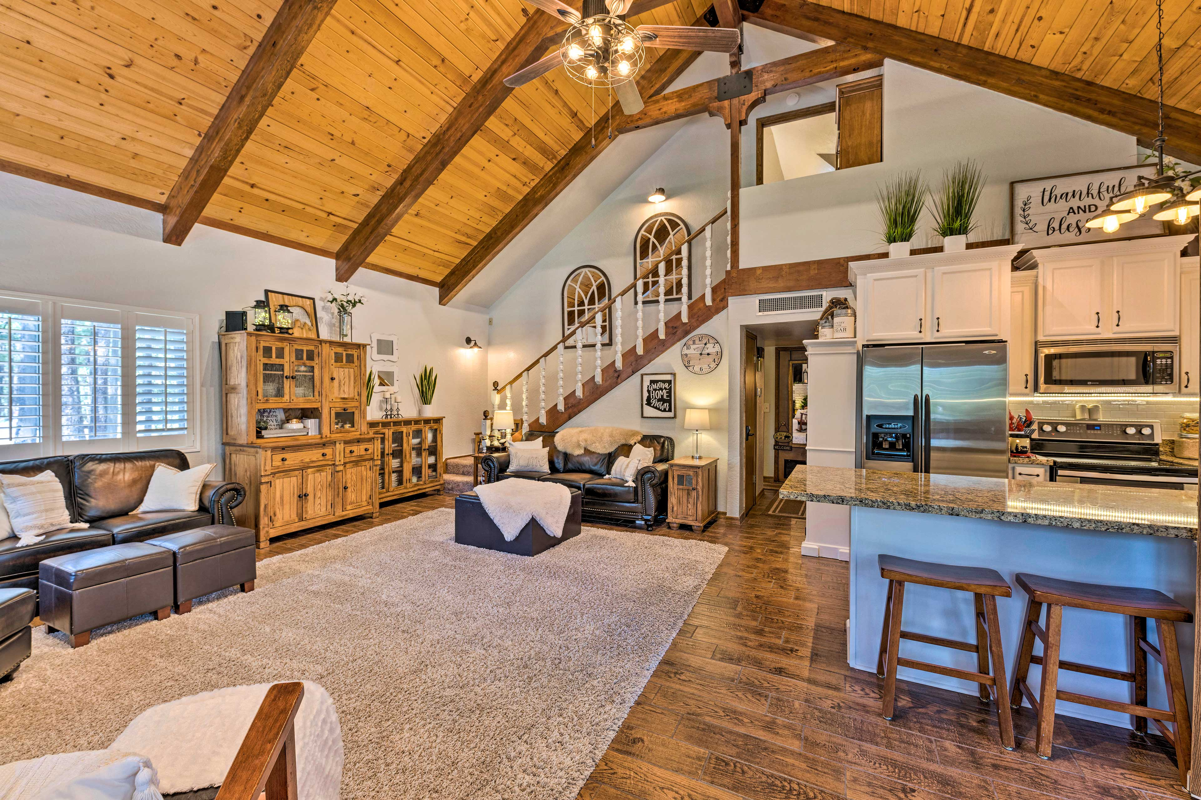 This home features hardwood floors and high ceilings.