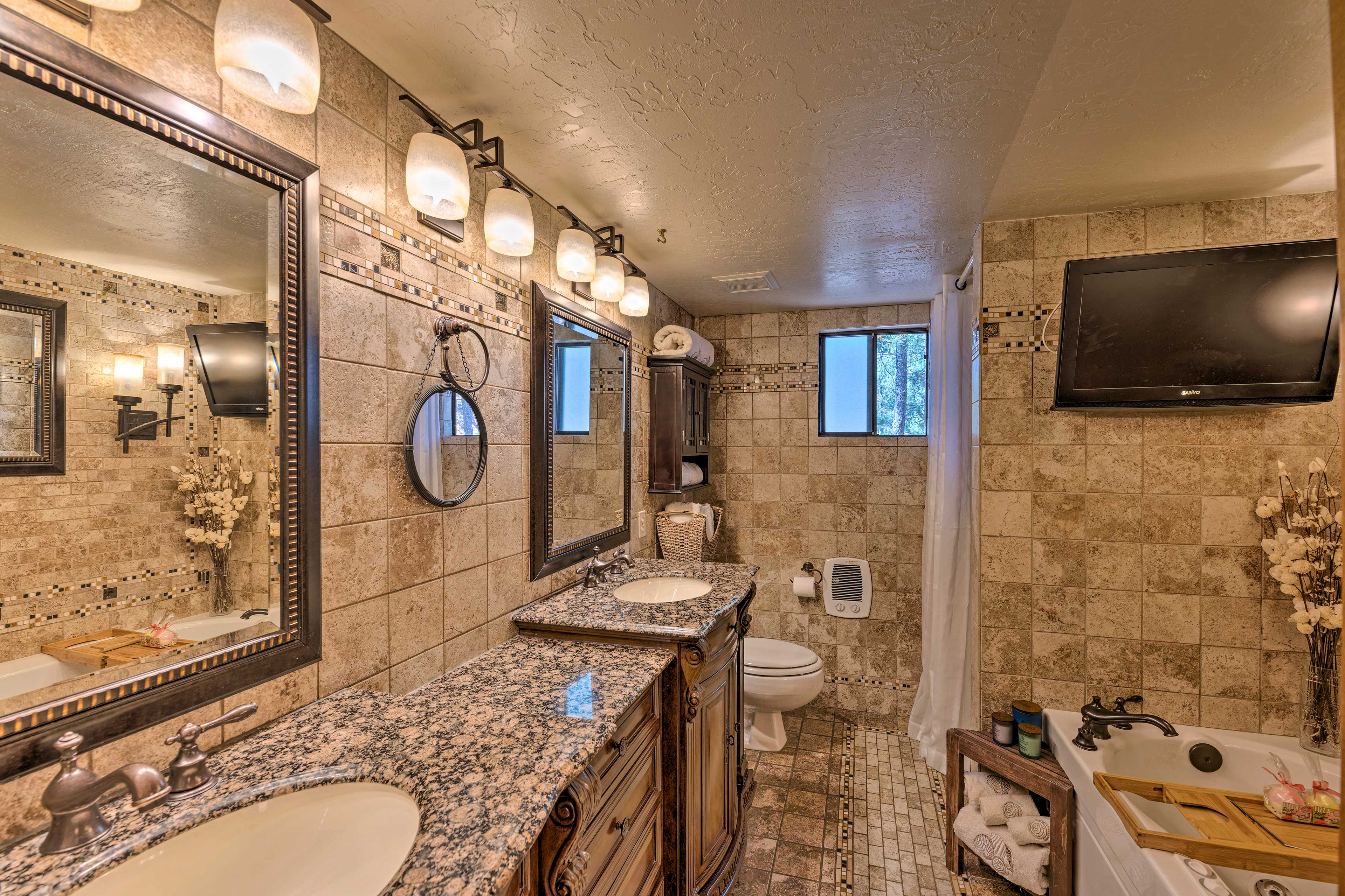 Two can get ready for the day in this bathroom with dual sinks.