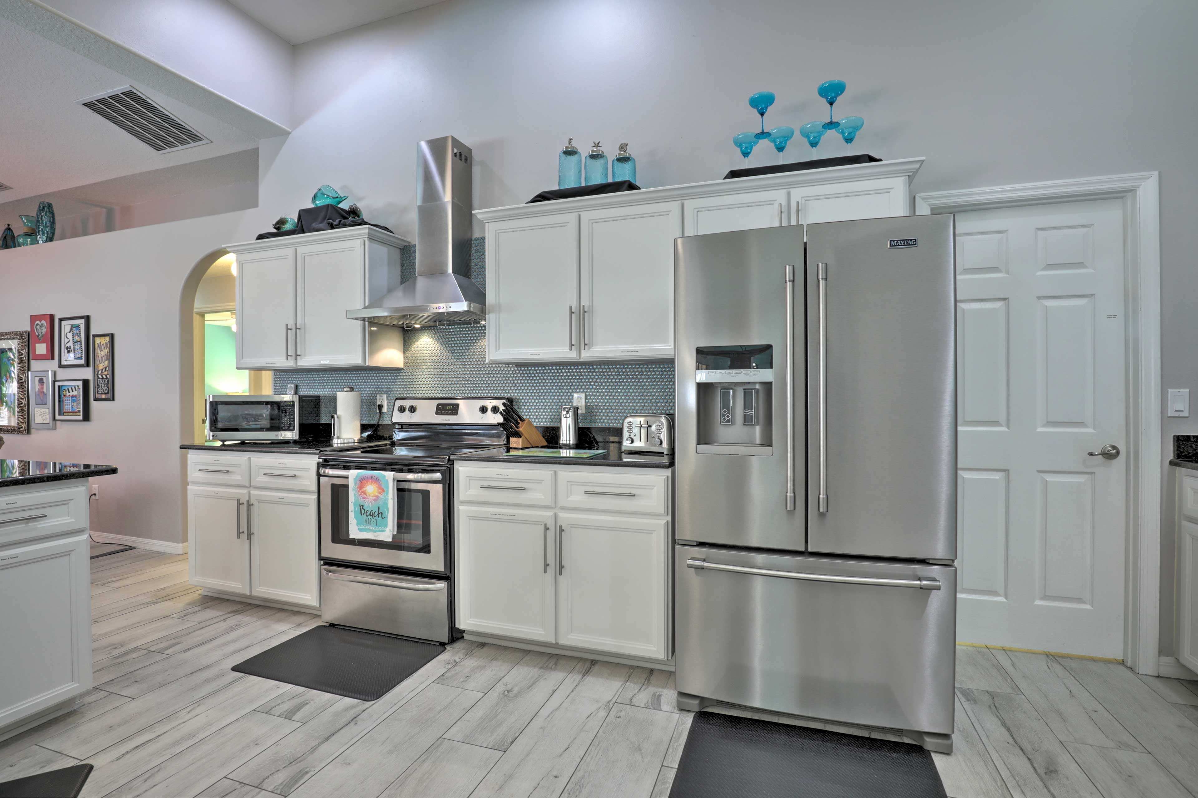 The kitchen is complete with granite counters and stainless steel appliances.