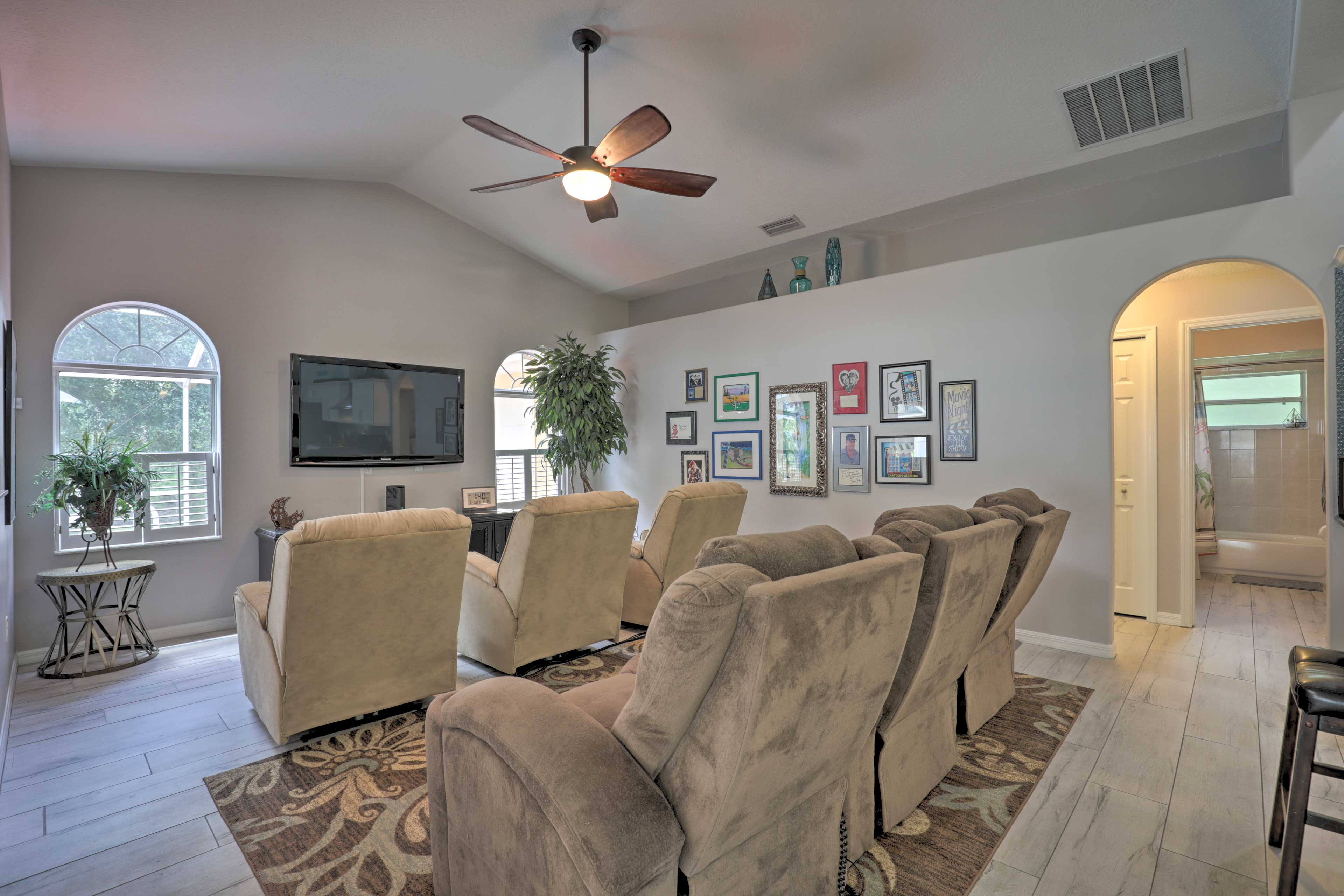 """Host a movie night on the 65"""" flat-screen TV in the theater room."""