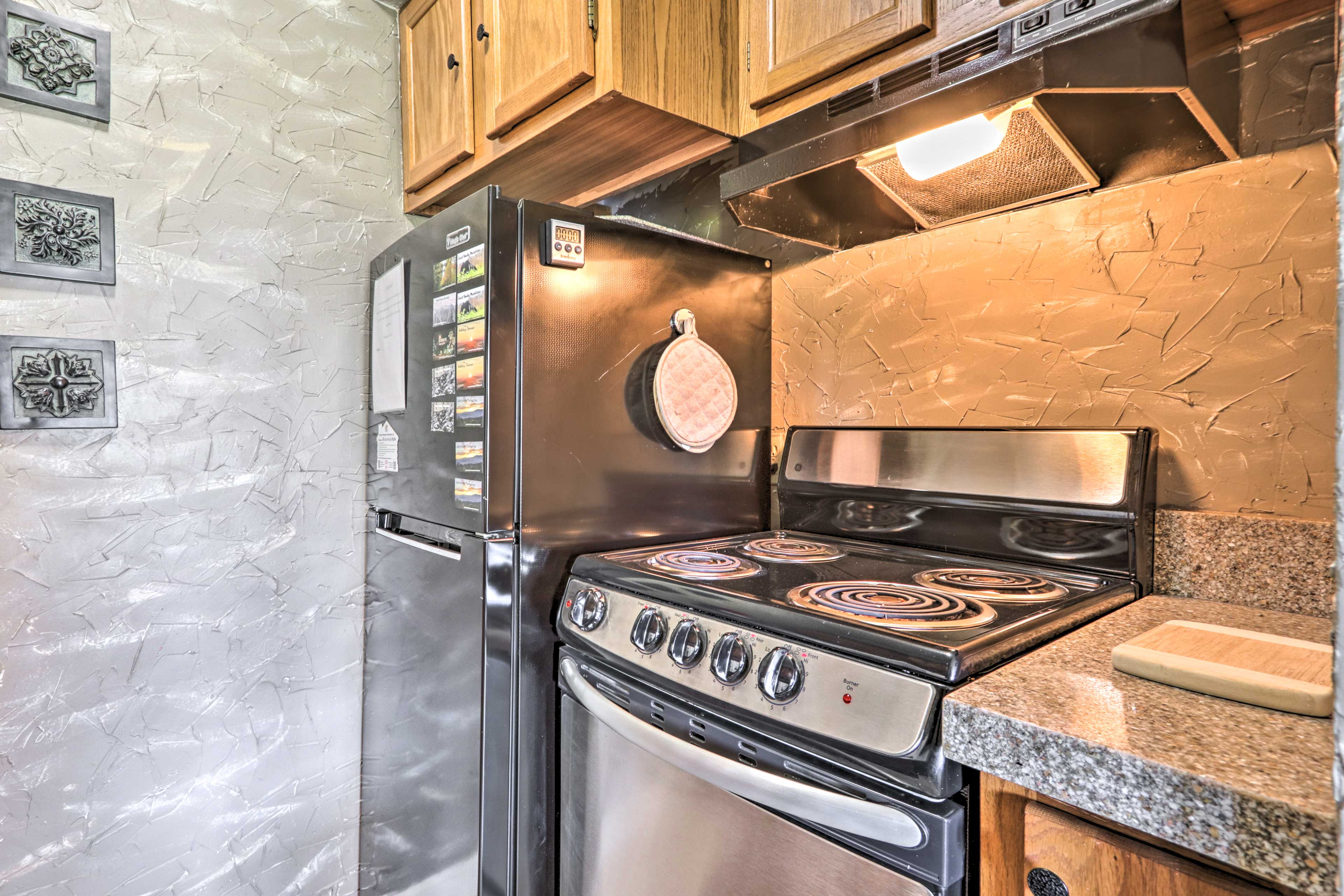 This kitchen comes fully equipped with a dishwasher and stove.