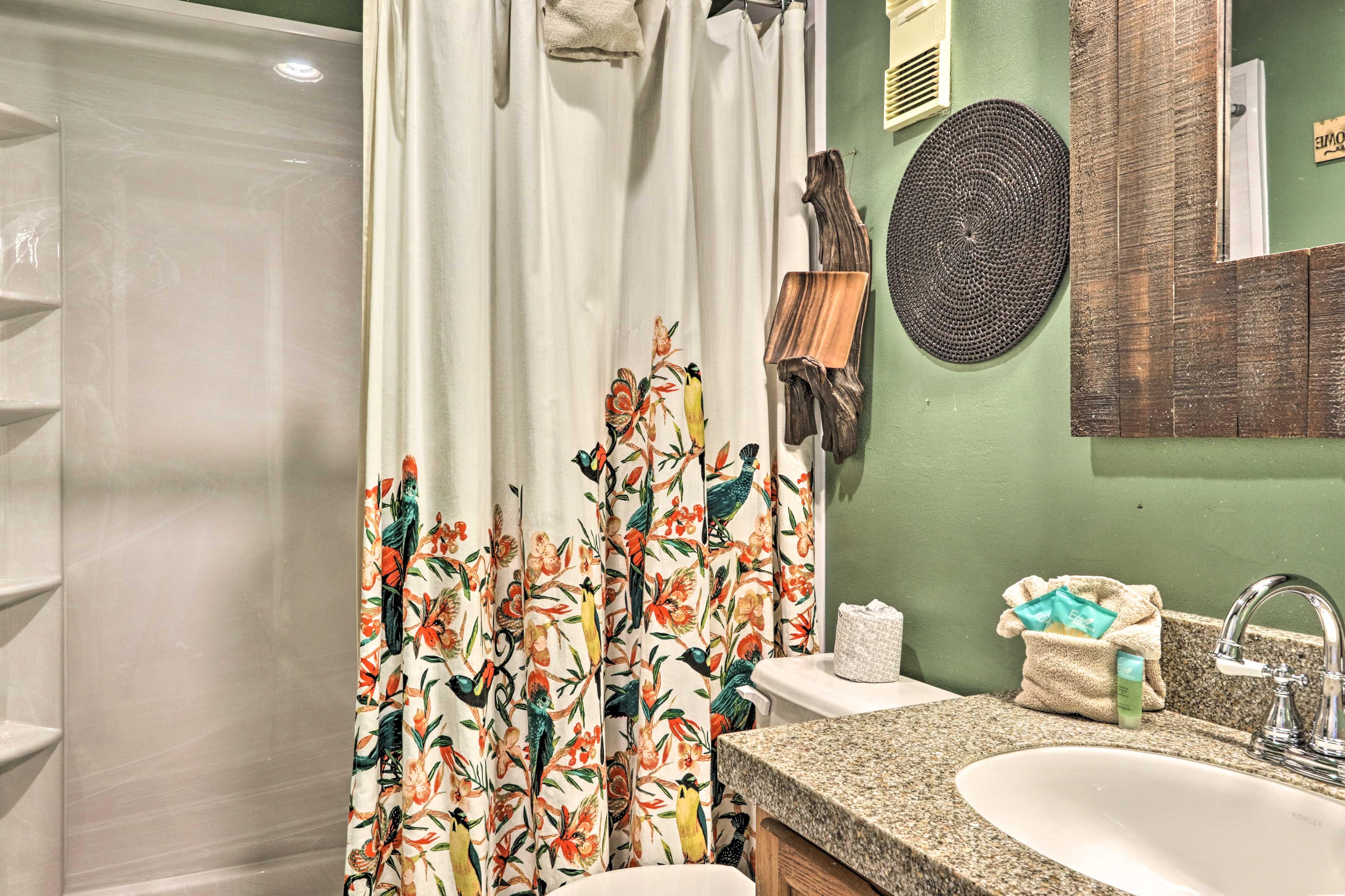 The bathroom provides basic toiletries.