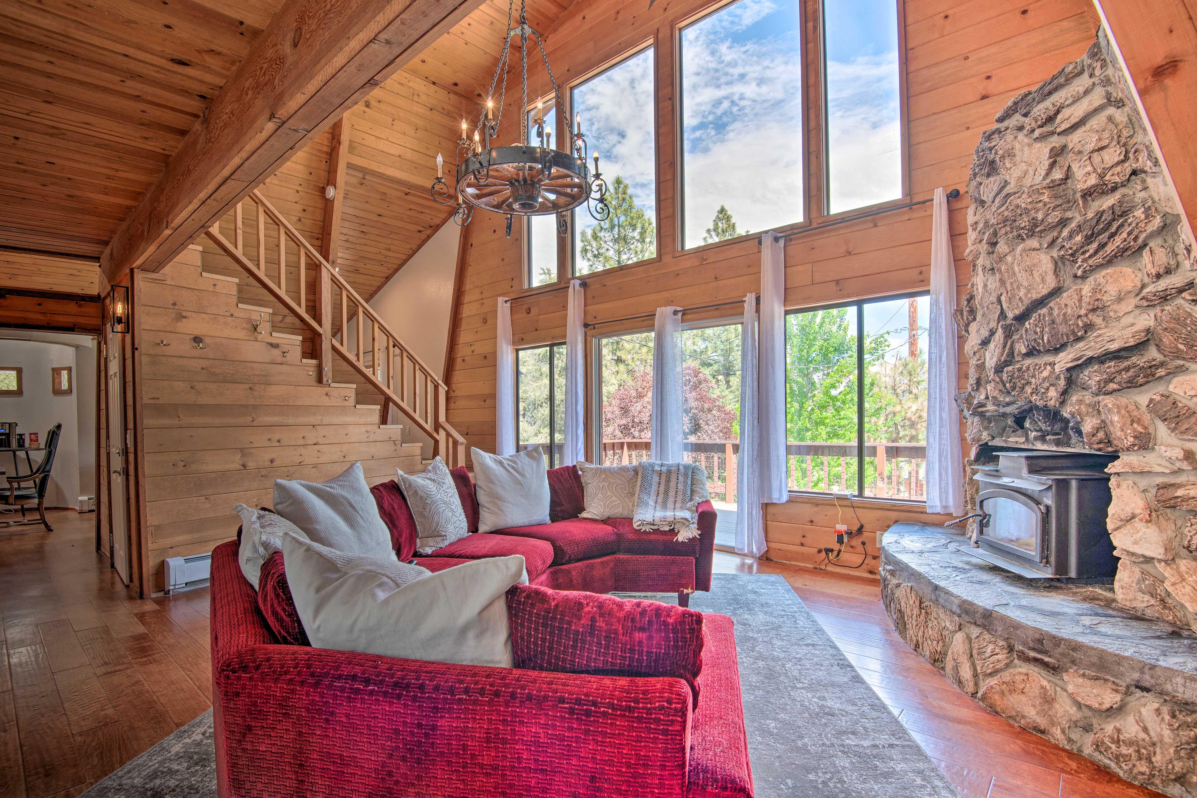 Floor-to-ceiling windows illuminate the interior space.