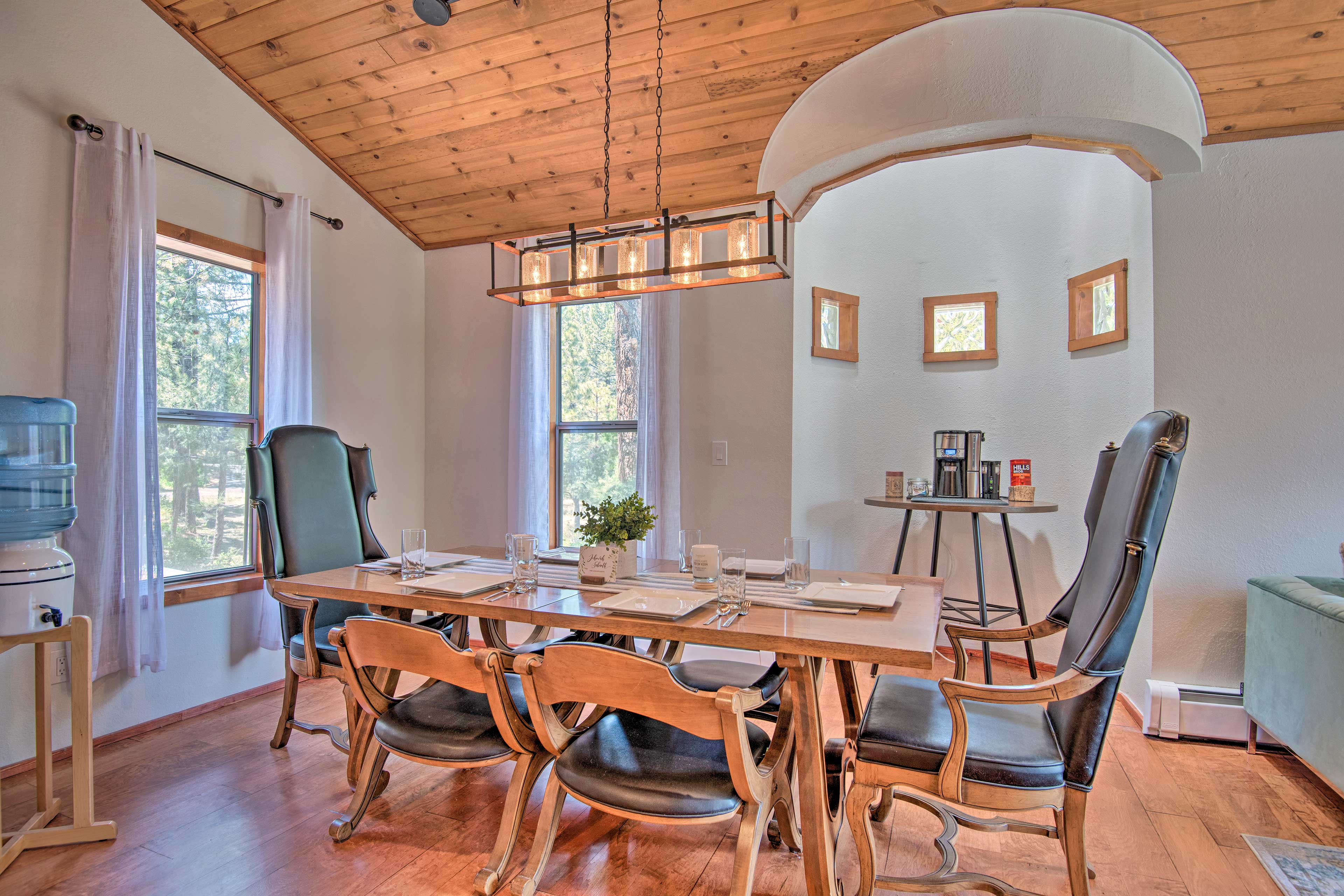 Family & friends can gather for a meal at the formal dining table.