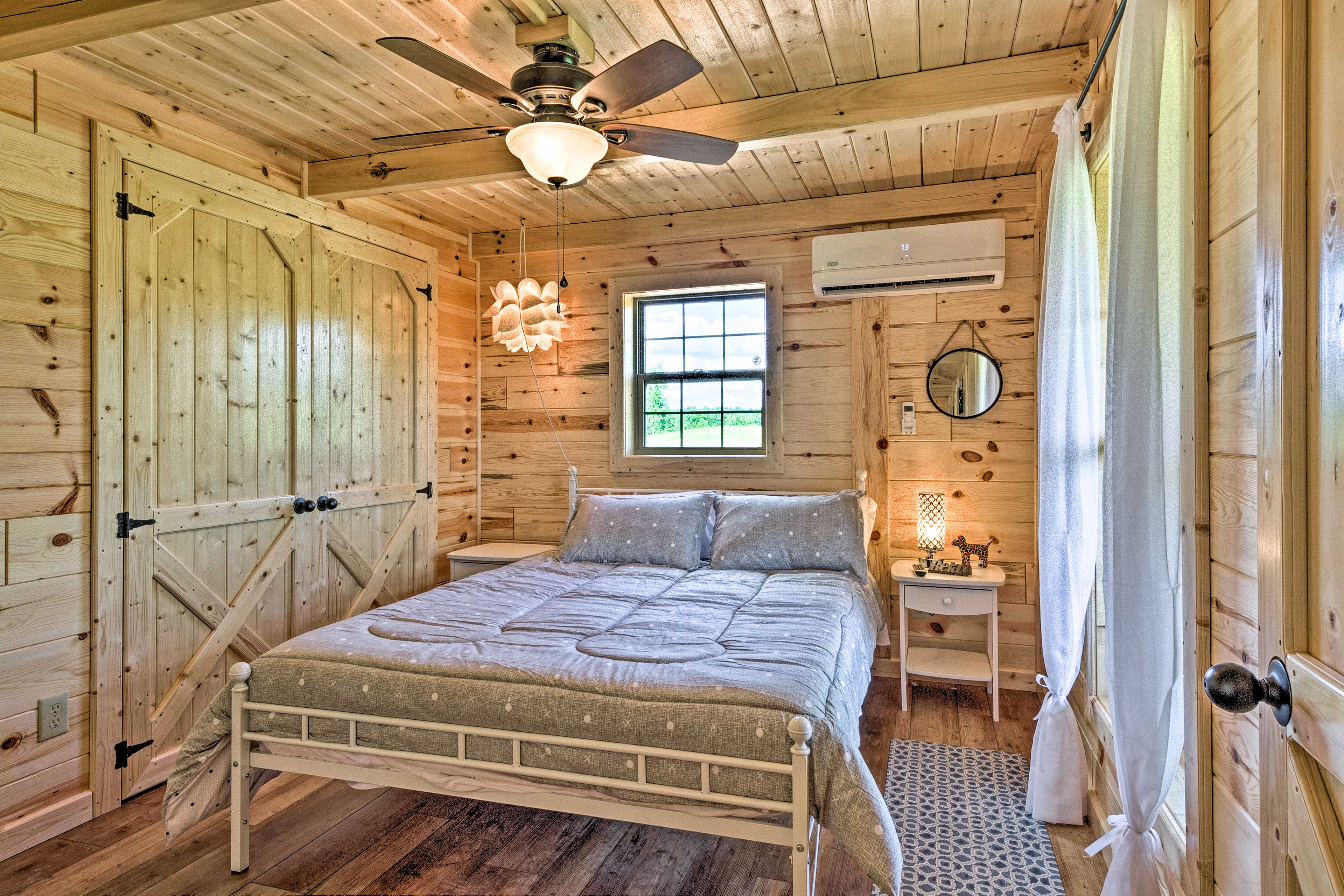 This bedroom is complete with a queen bed.