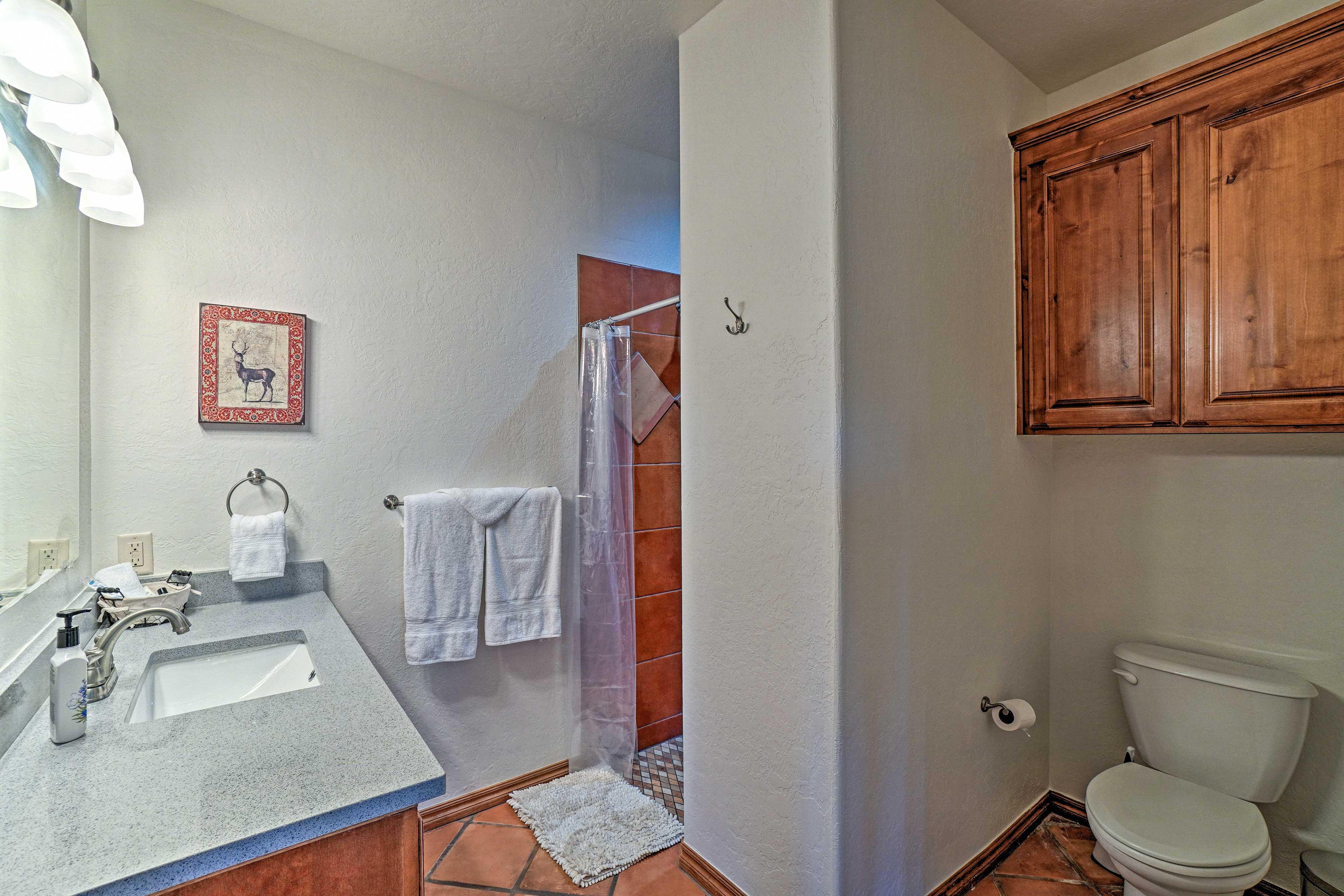 A full bathroom has a walk-in shower.