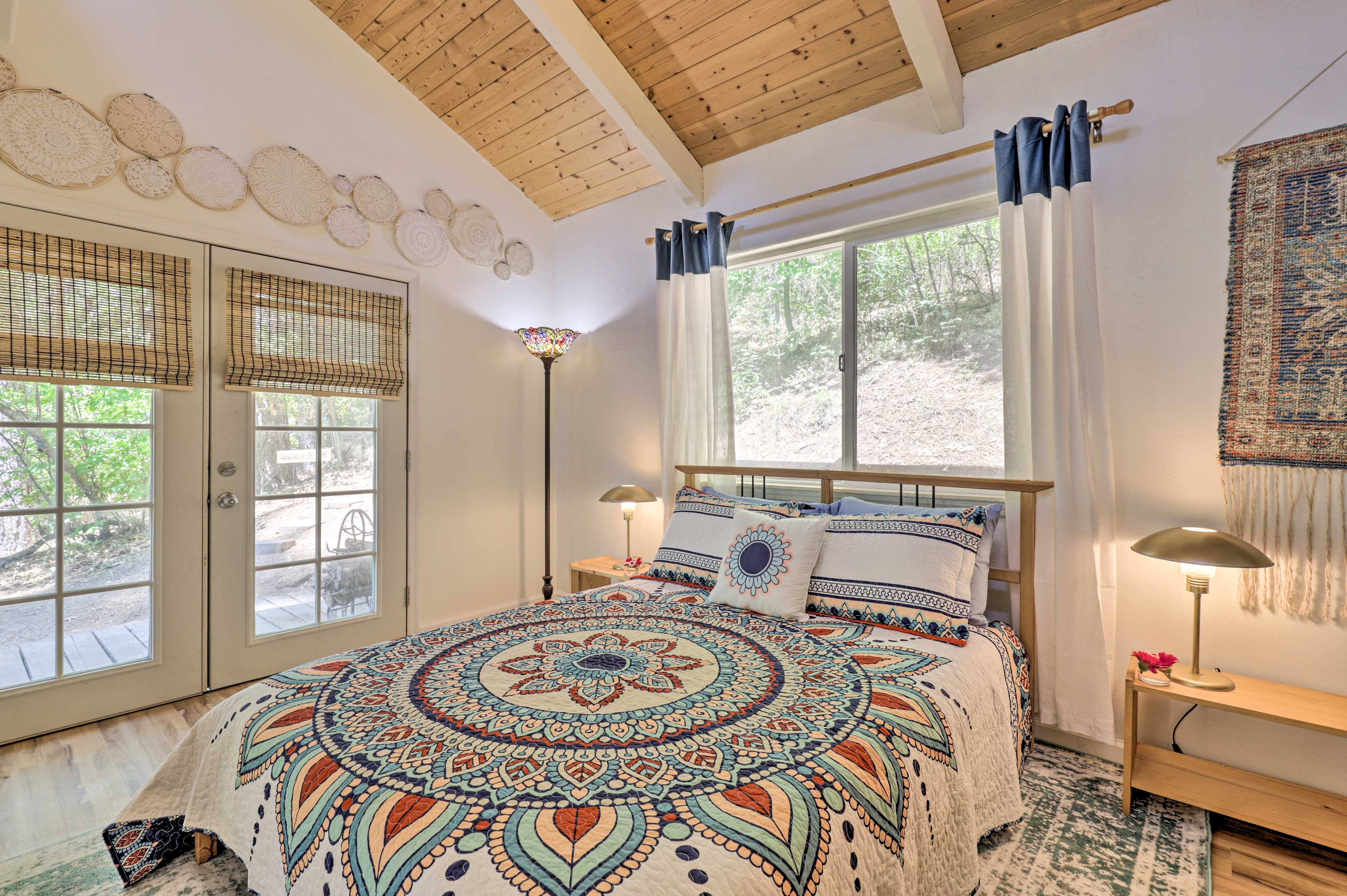 Spread out on this bedroom's queen bed.