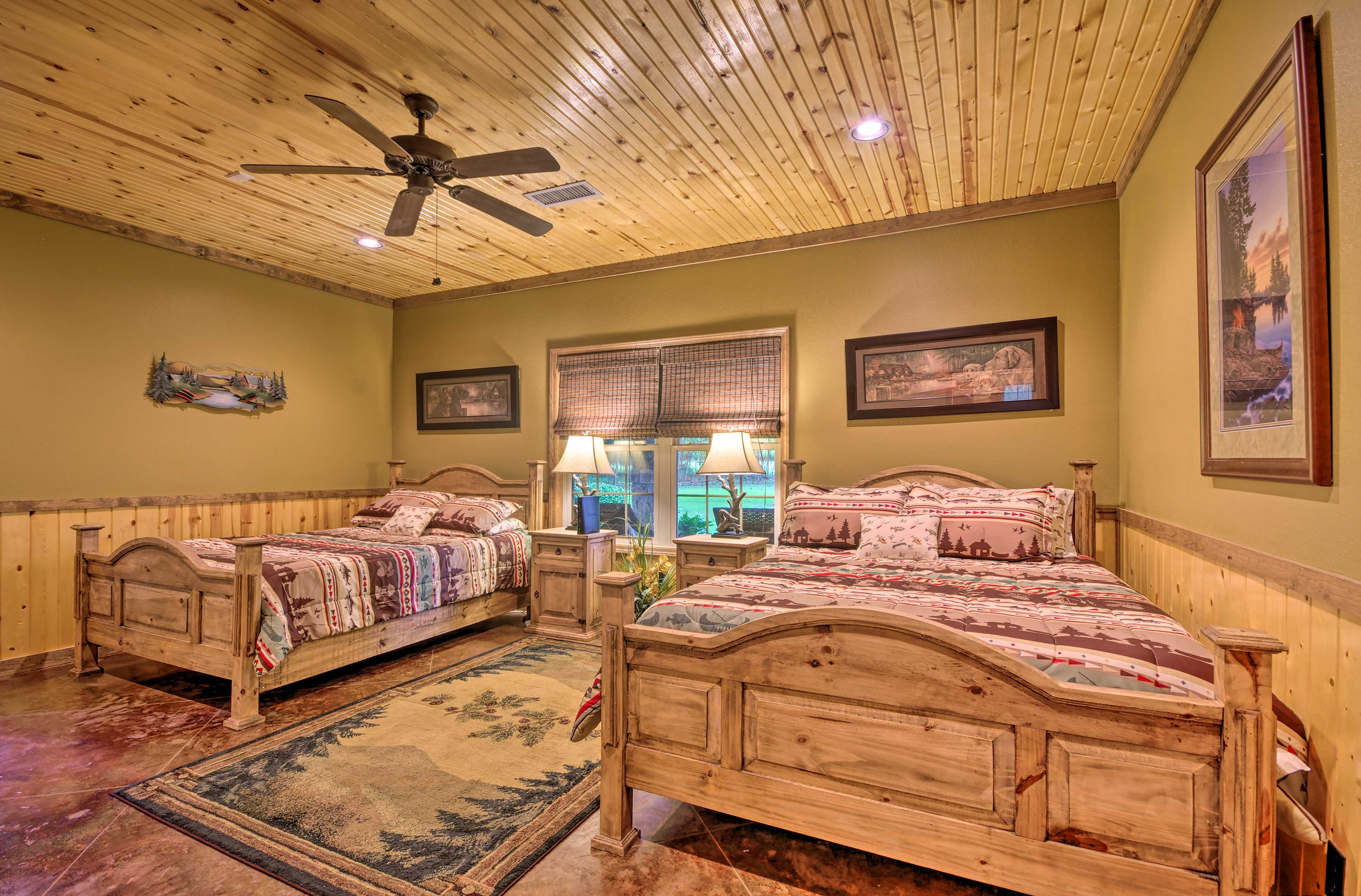 The master bedroom features 2 queen-sized beds.
