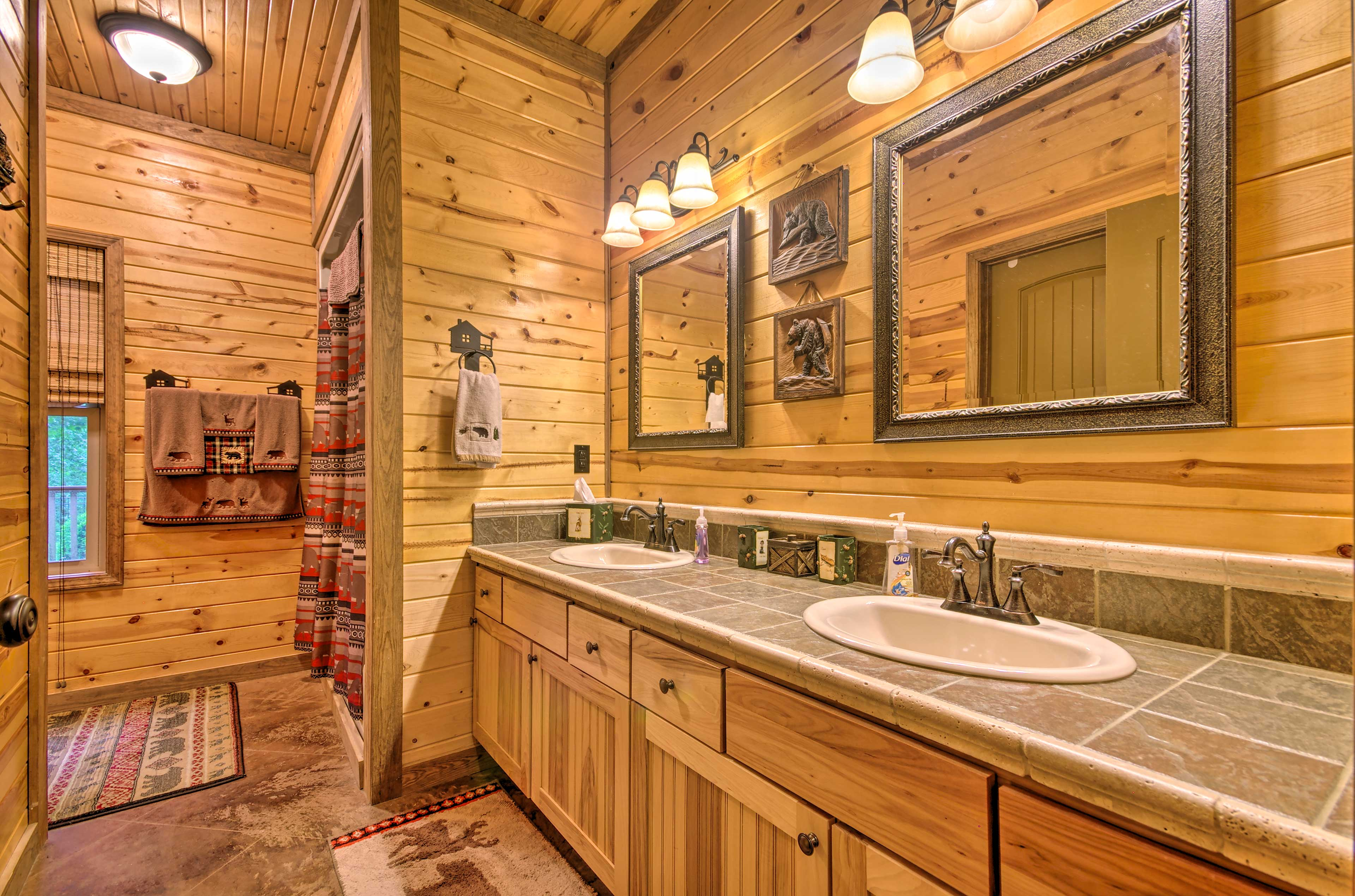 The master bathroom features dual sinks and a walk-in shower.