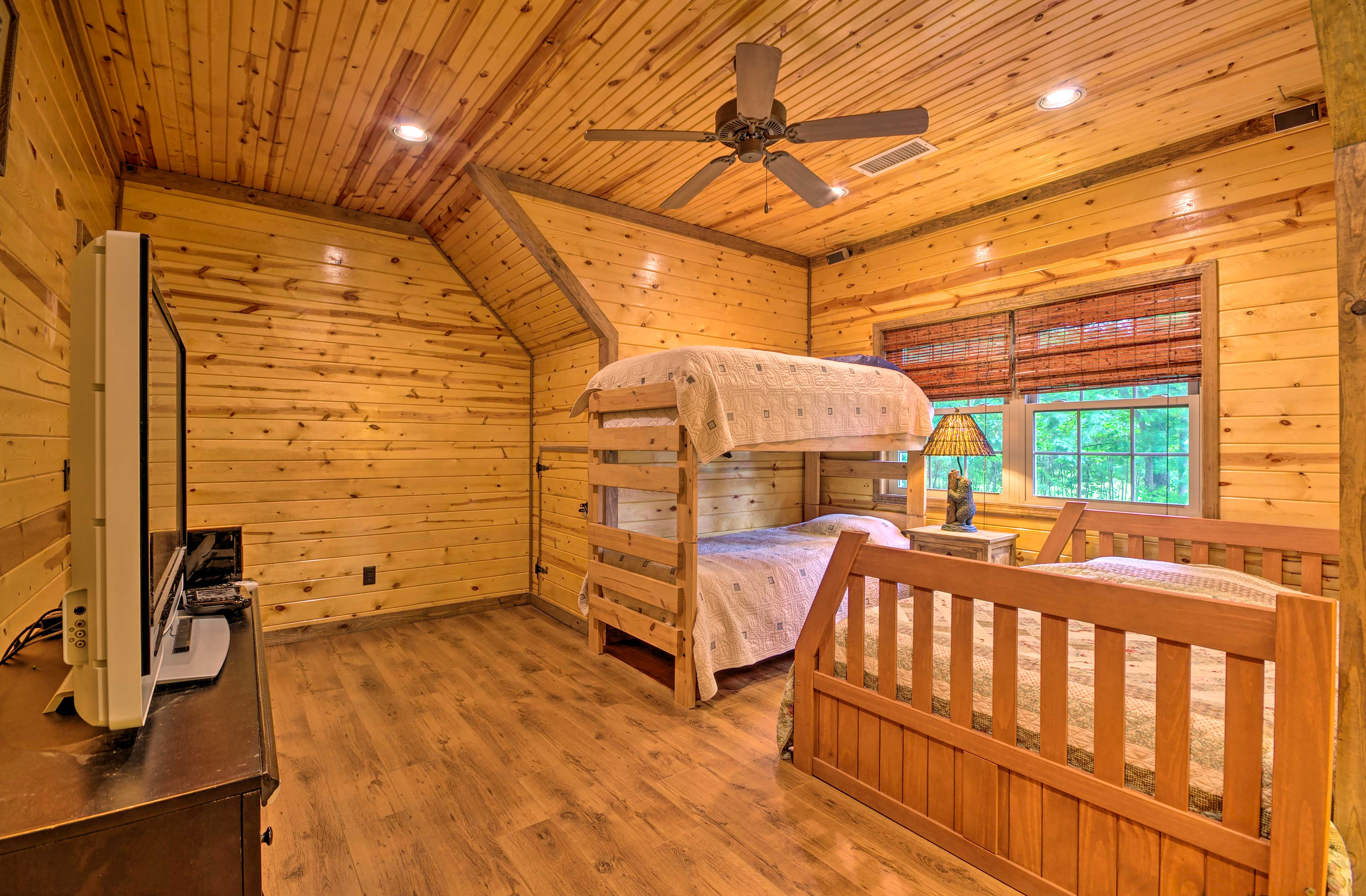 The second bedroom features a full bed and twin bunk beds.