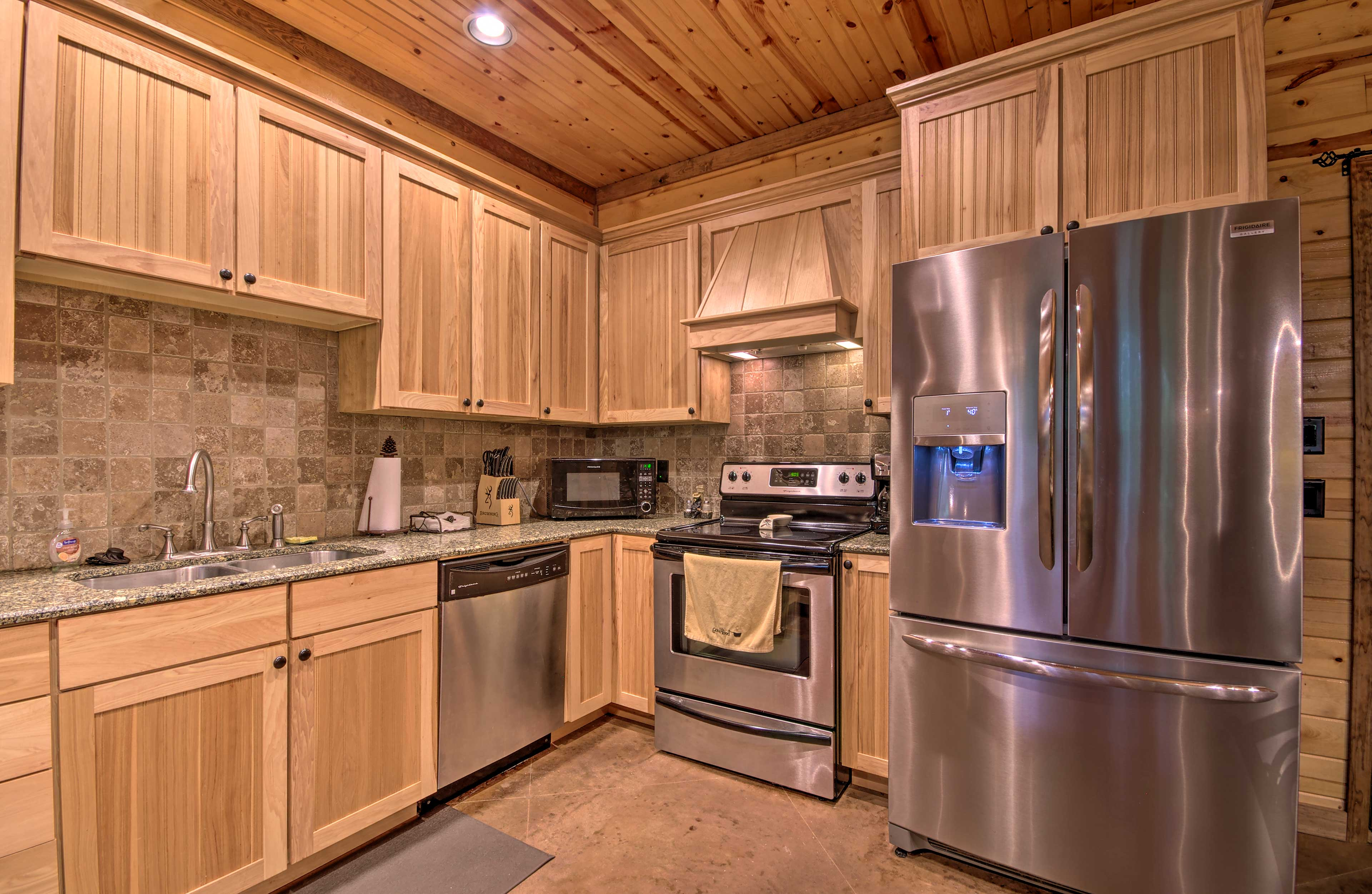 The stainless steel appliances and sleek cabinetry give a tasteful feel.