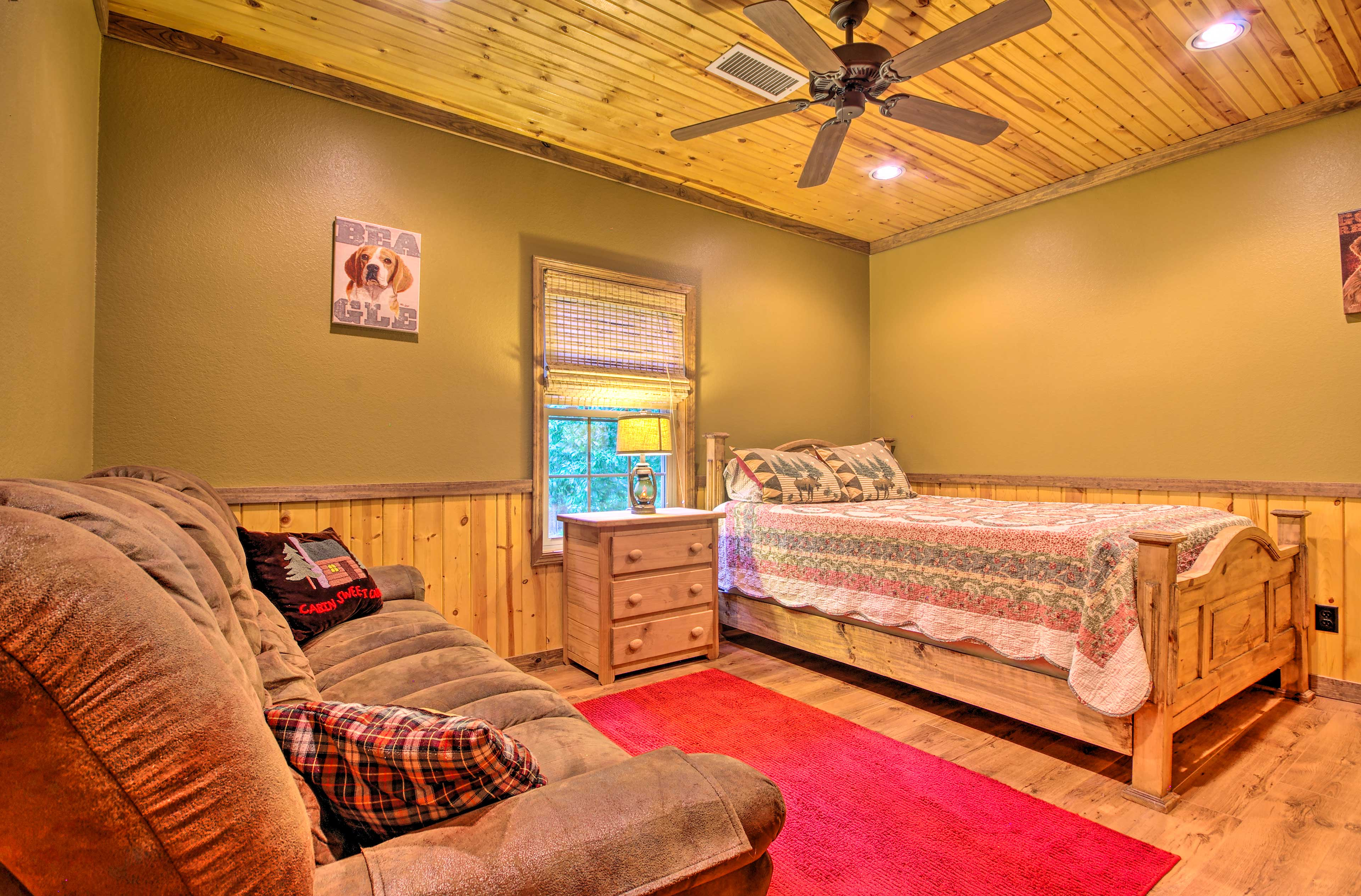 The fourth bedroom features a queen-sized bed.