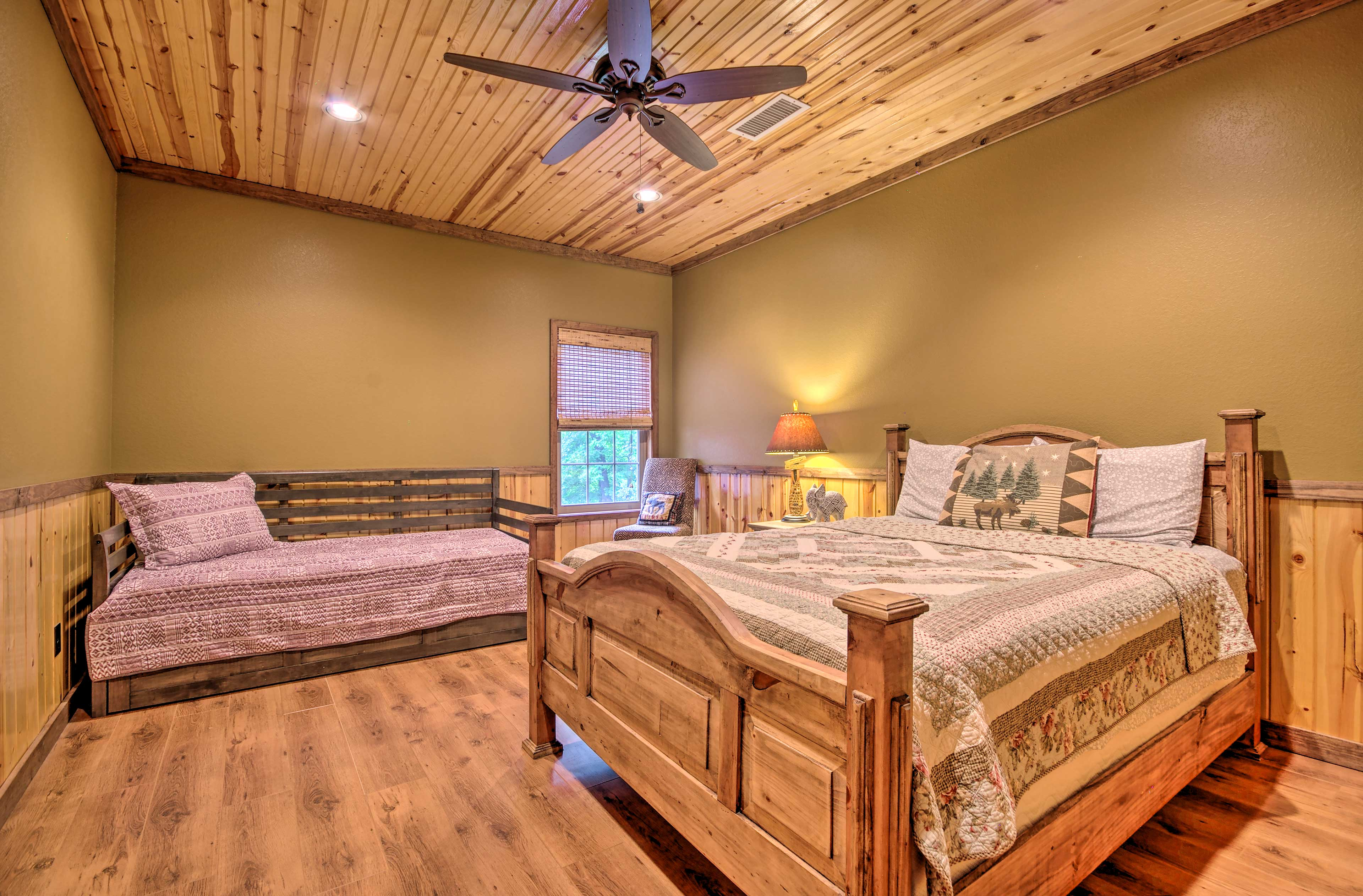 The third bedroom features a queen bed and a twin day bed with a twin trundle.
