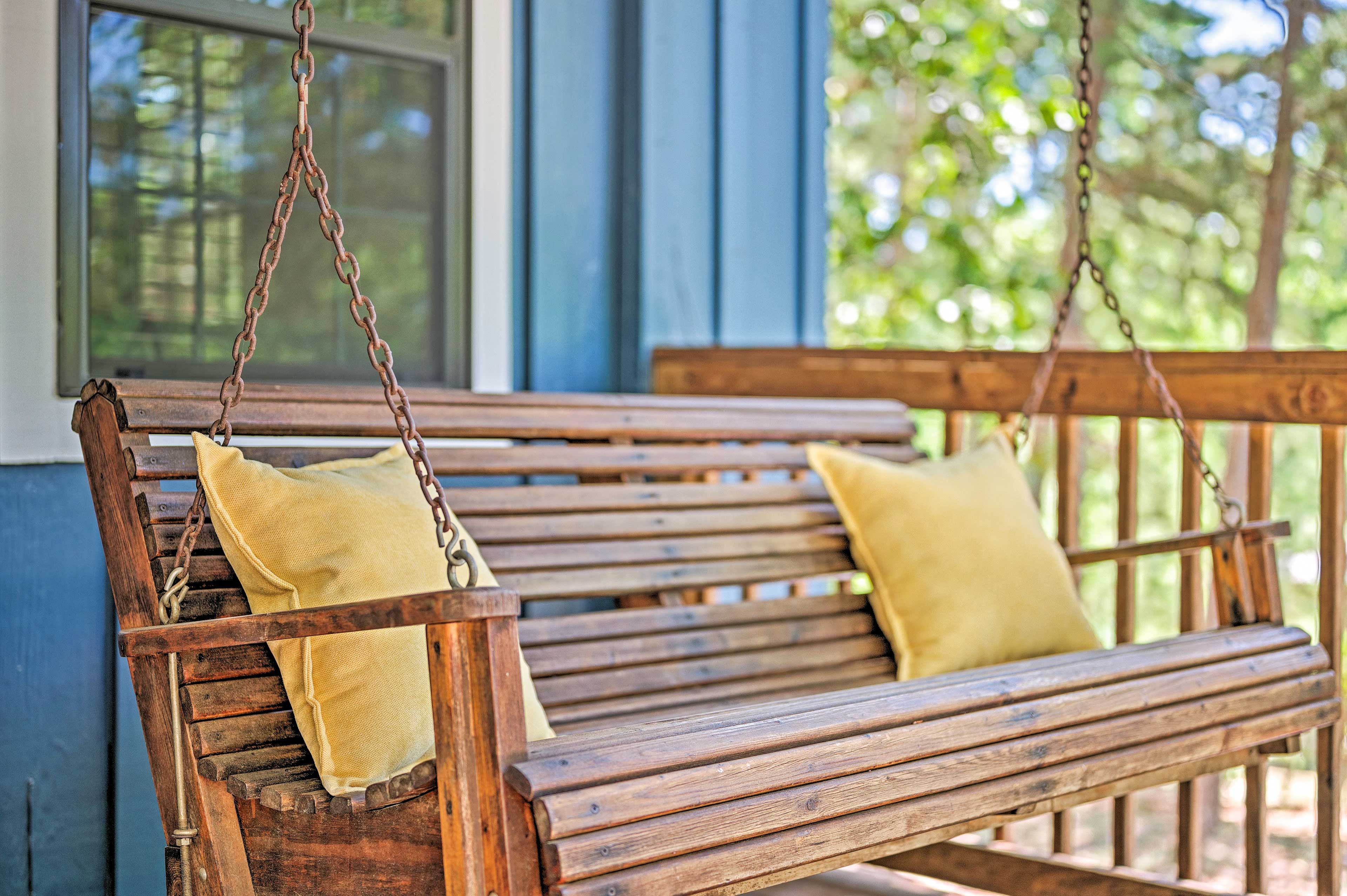 The covered front porch is the perfect place to unwind.