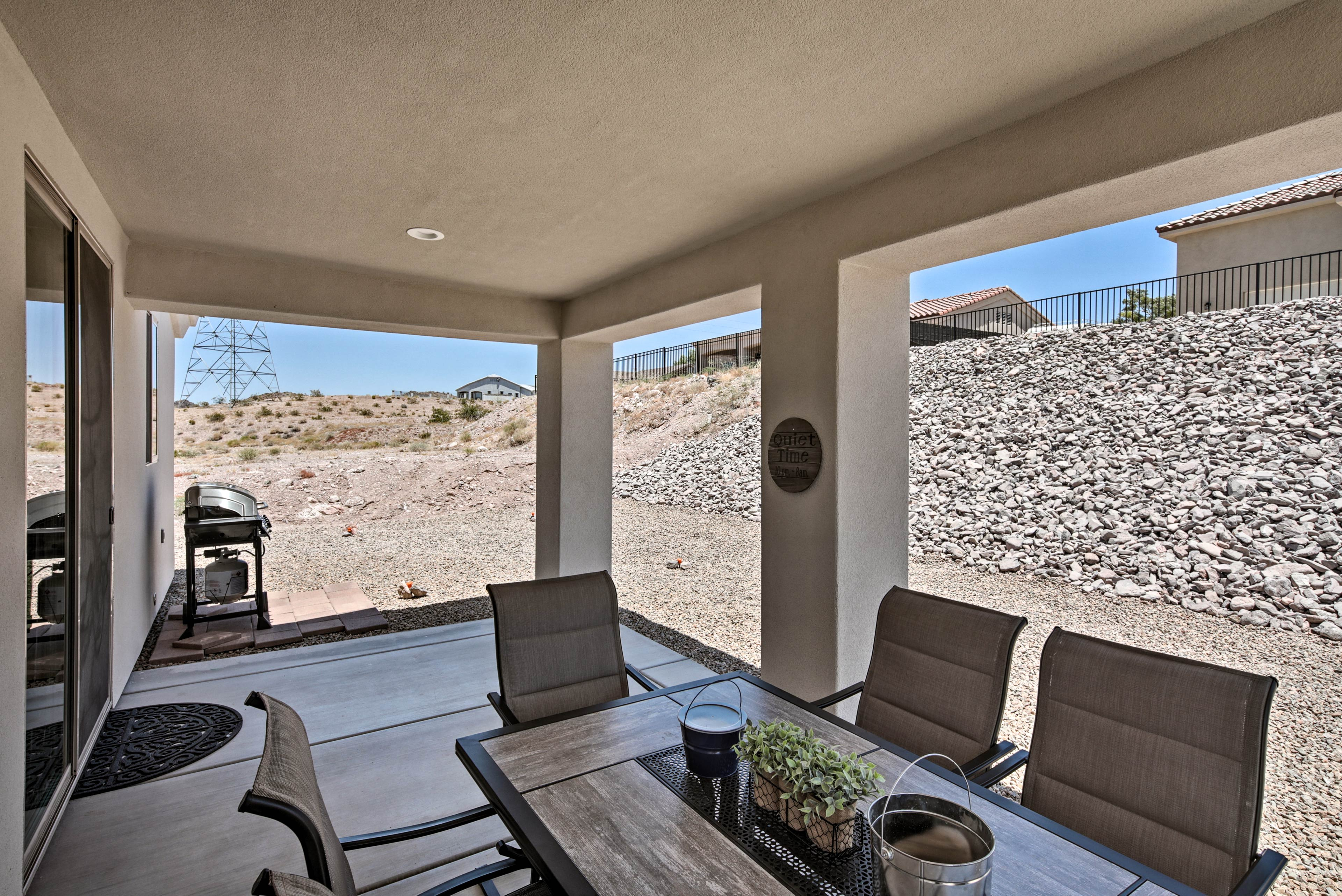 This vacation rental features an updated outdoor space with a dining table!