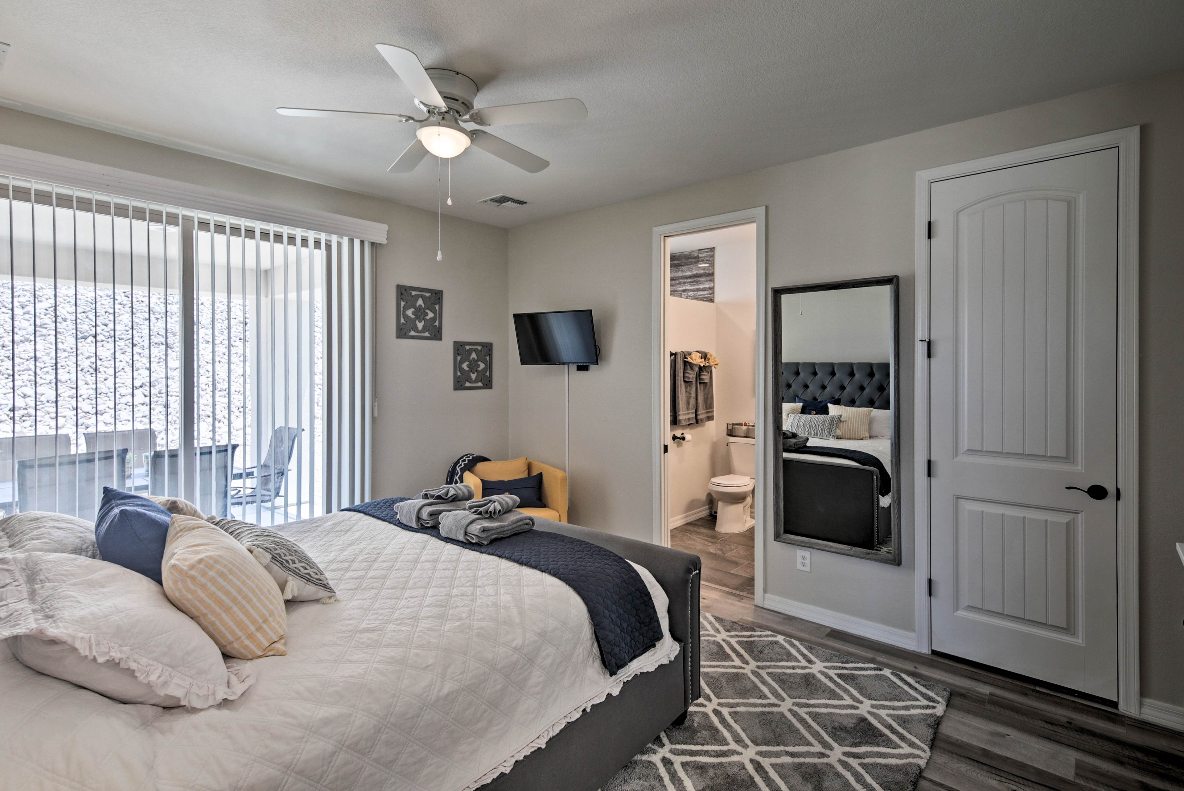 Relax in the master bedroom's California King-sized bed.