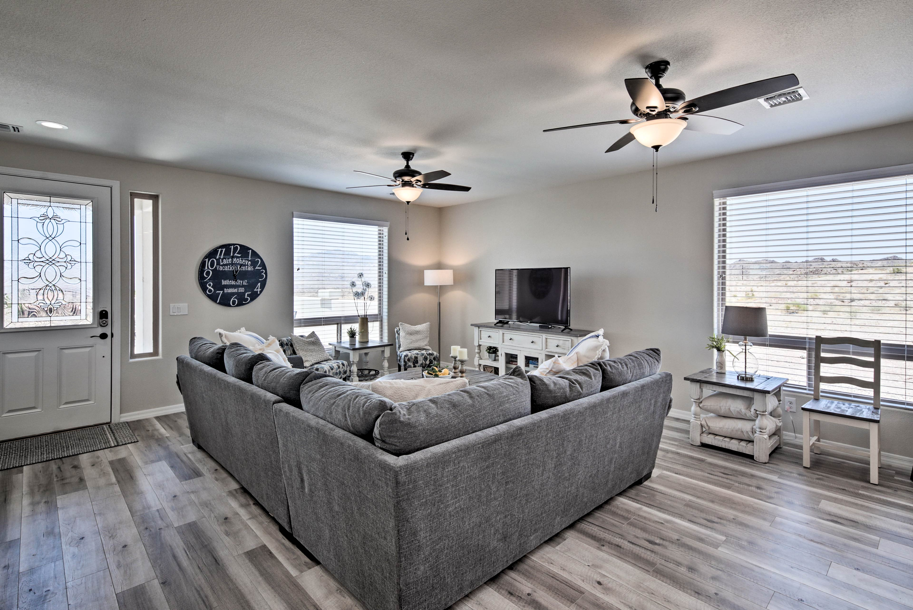 The interior living space features modern-style furnishings and a Smart TV.