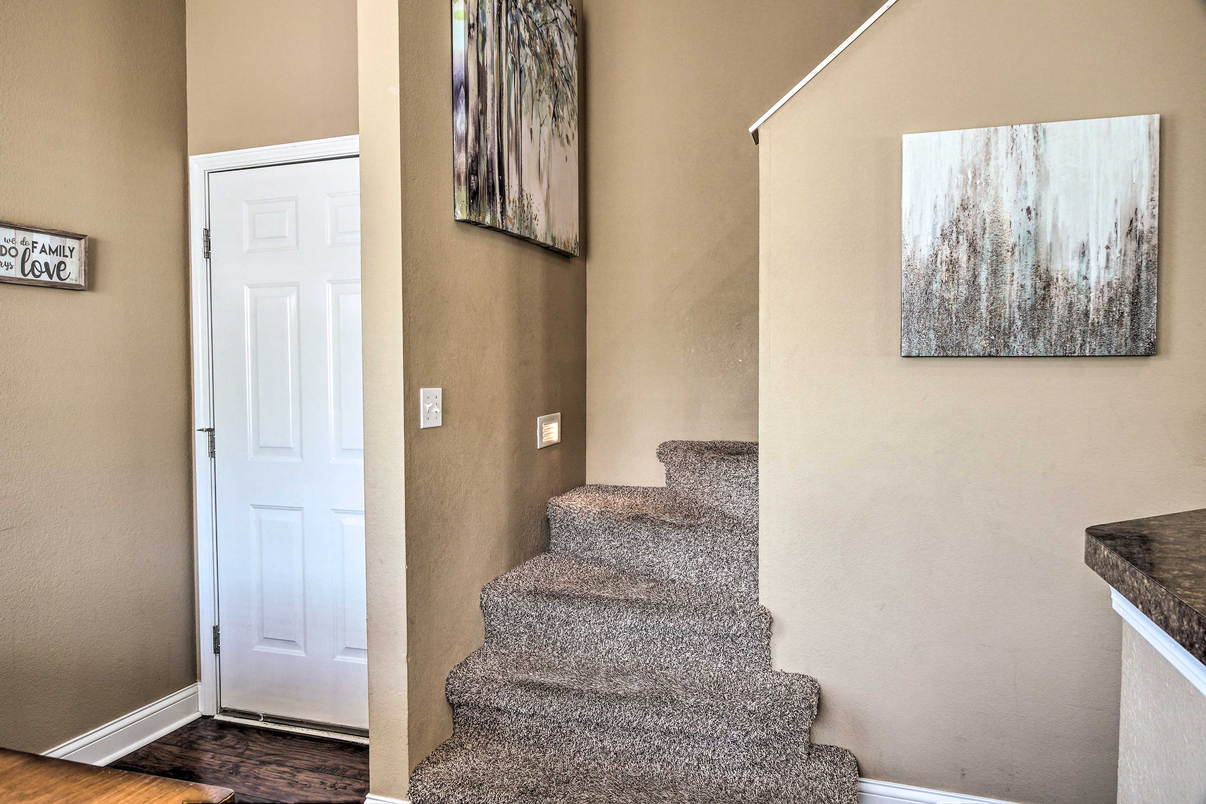 Stairs take you up to multiple bedrooms.