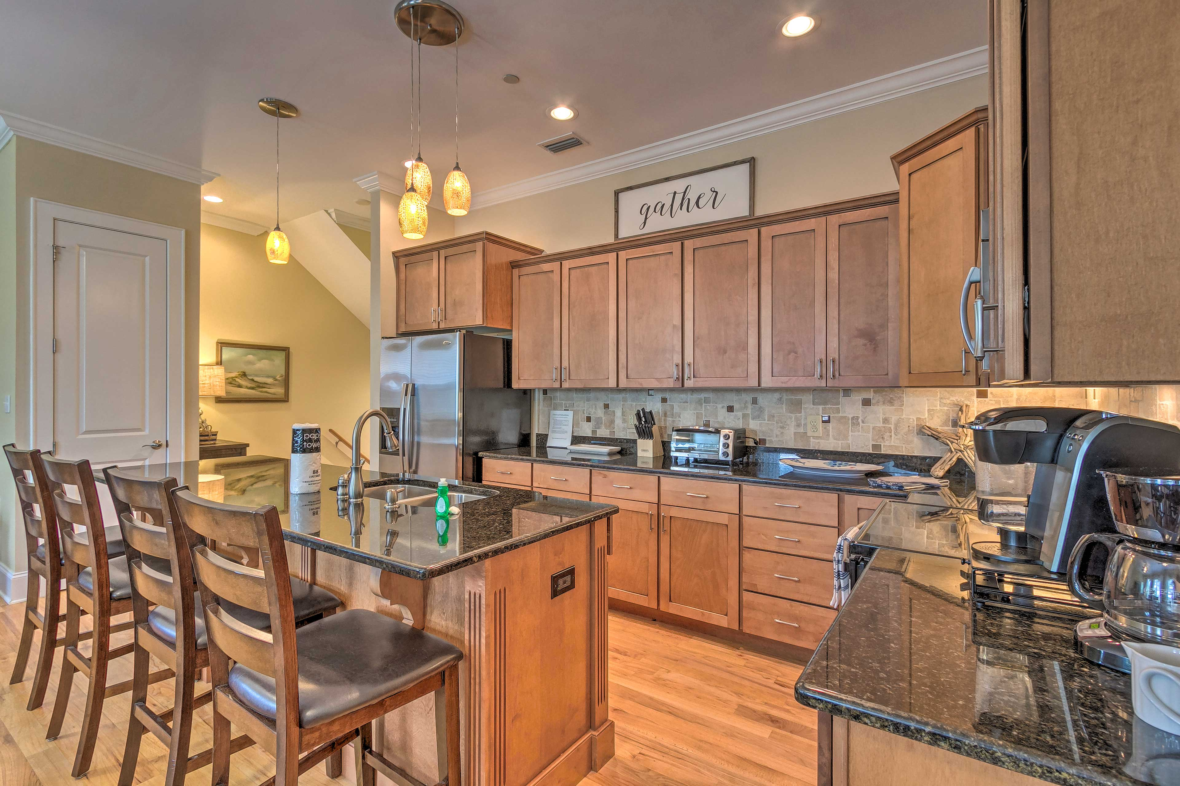 This 3-story retreat offers a pristine fully equipped kitchen.