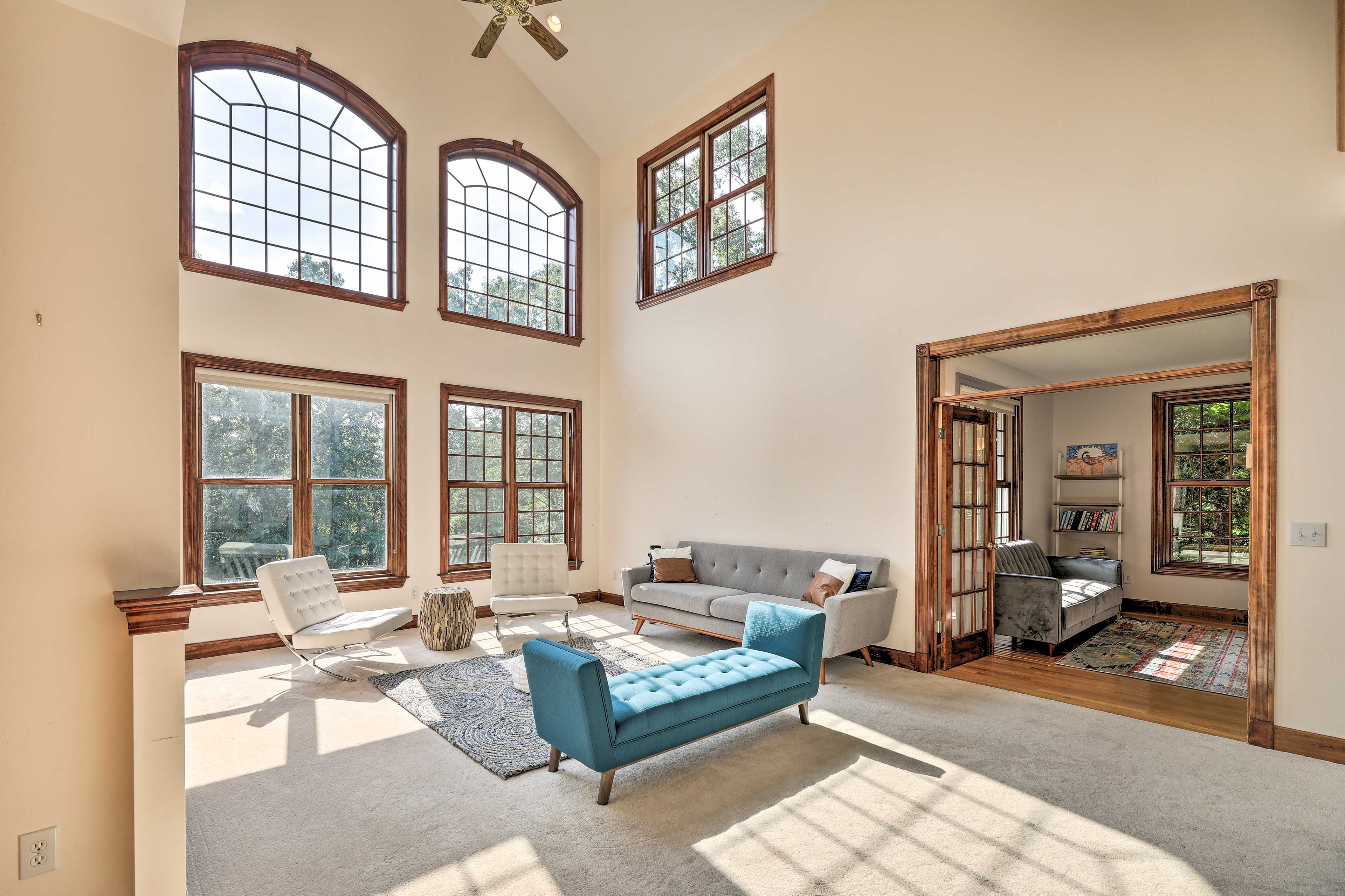 The home's many living spaces are illuminated with natural light.
