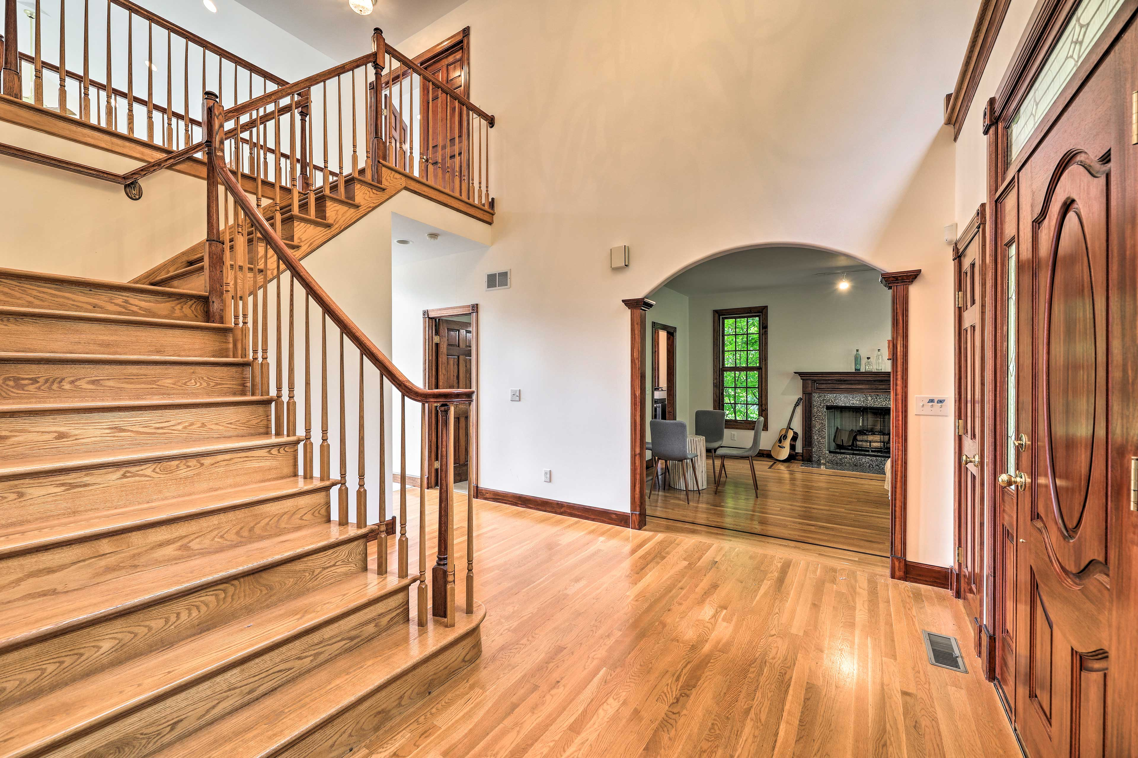 Head up the grand staircase to claim your bedroom!