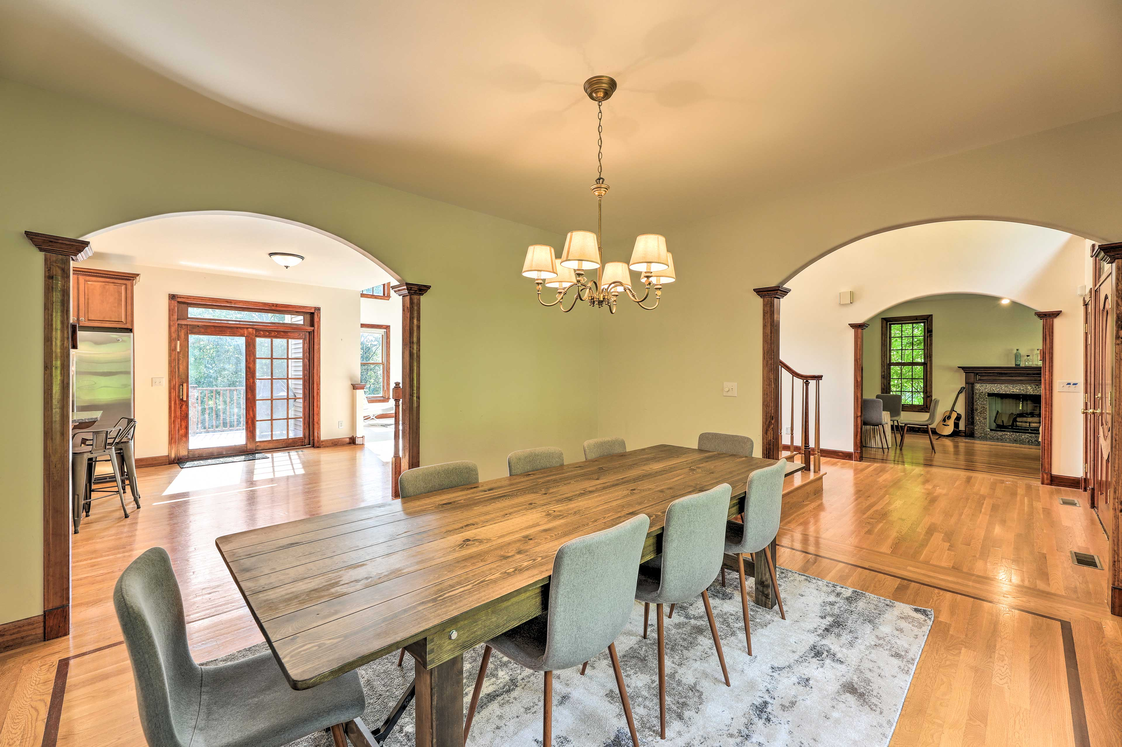 The dining room boasts a beautiful wooden table fit for your special meals.