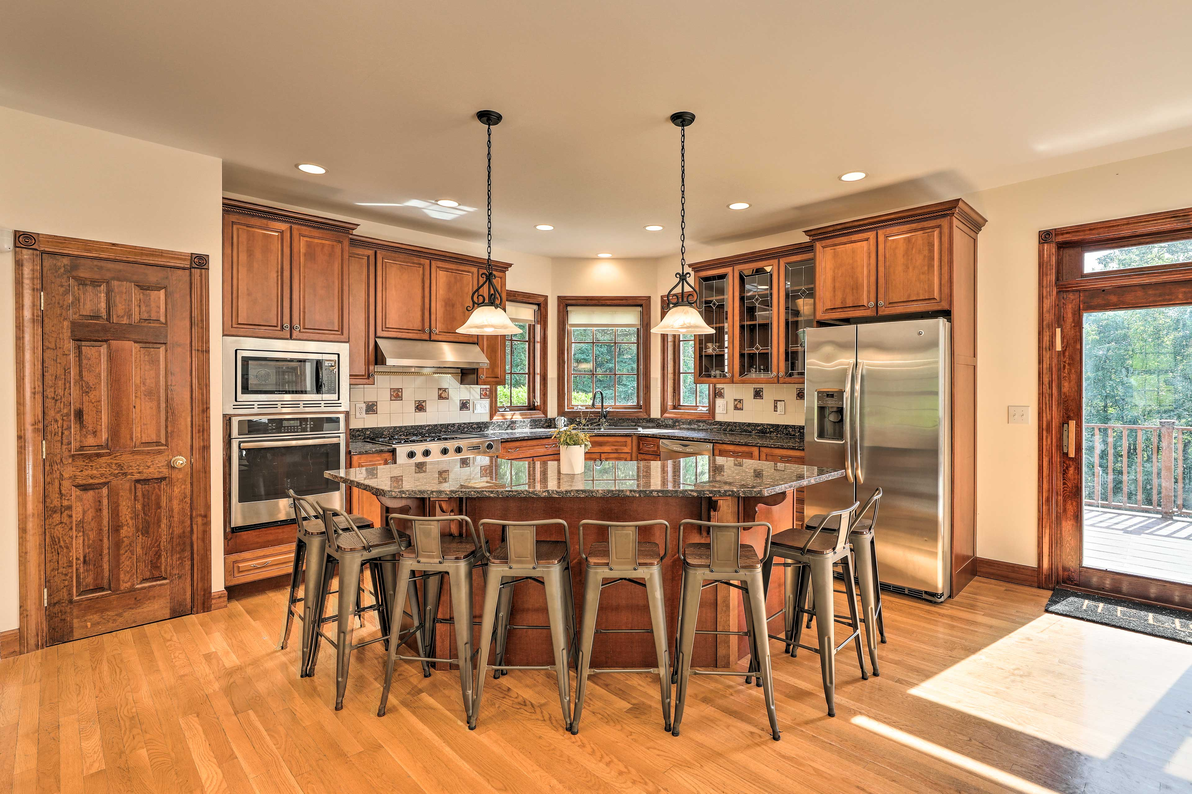 The gourmet kitchen is equipped with all the essential amenities.