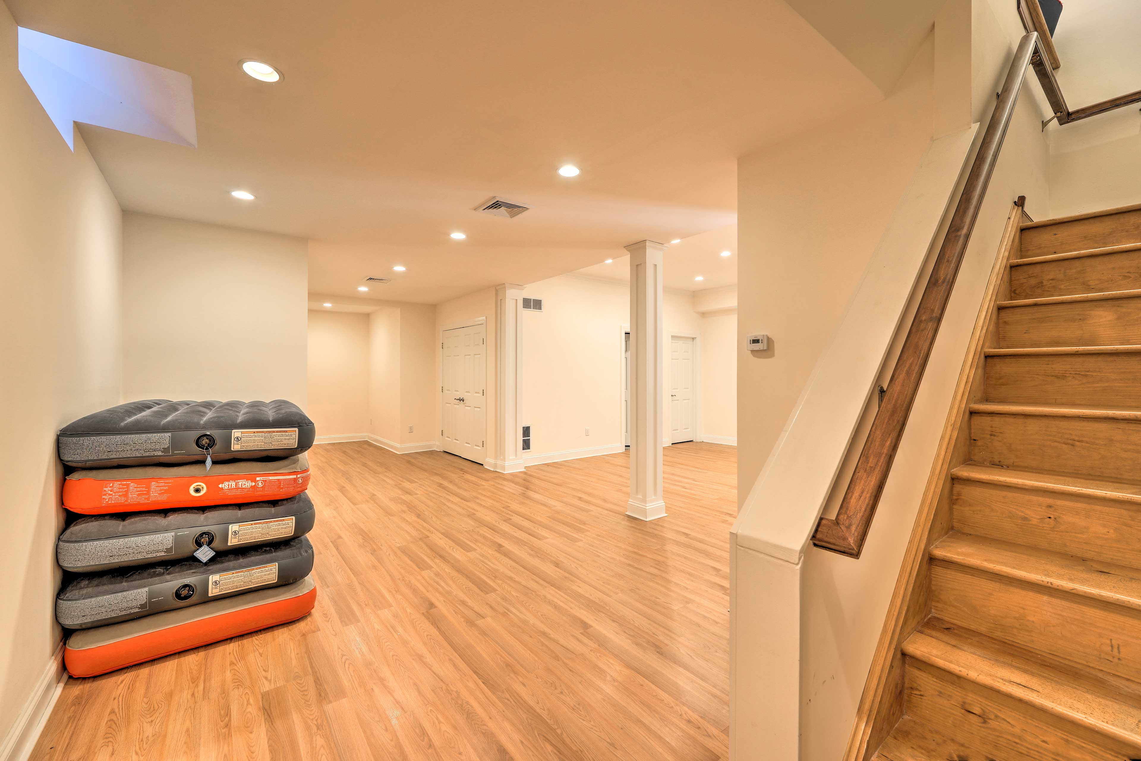 The spacious basement boasts a collection of air mattresses for your guests.
