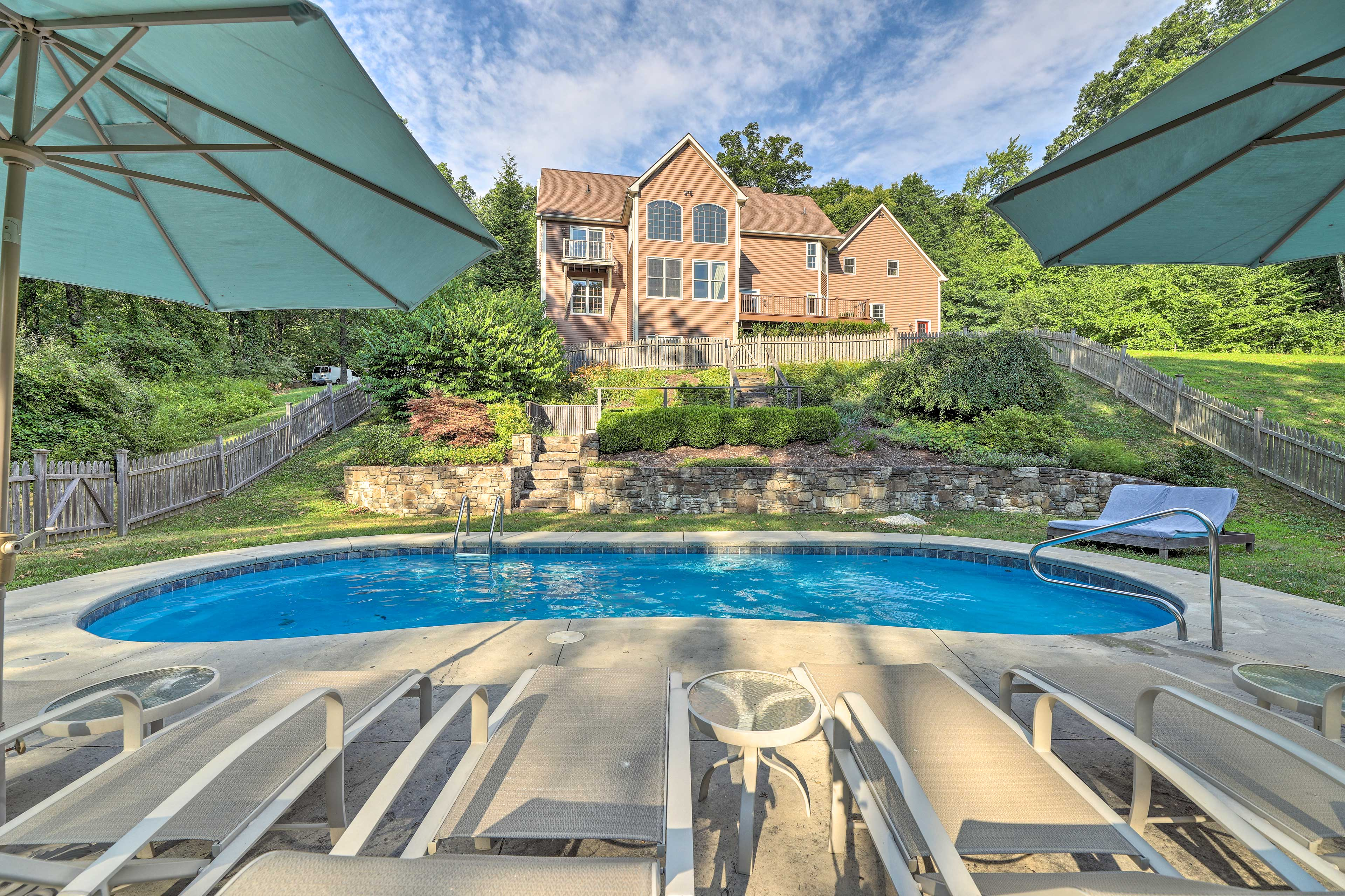 Head down the sloped yard to the private pool area, where you can lounge & swim!