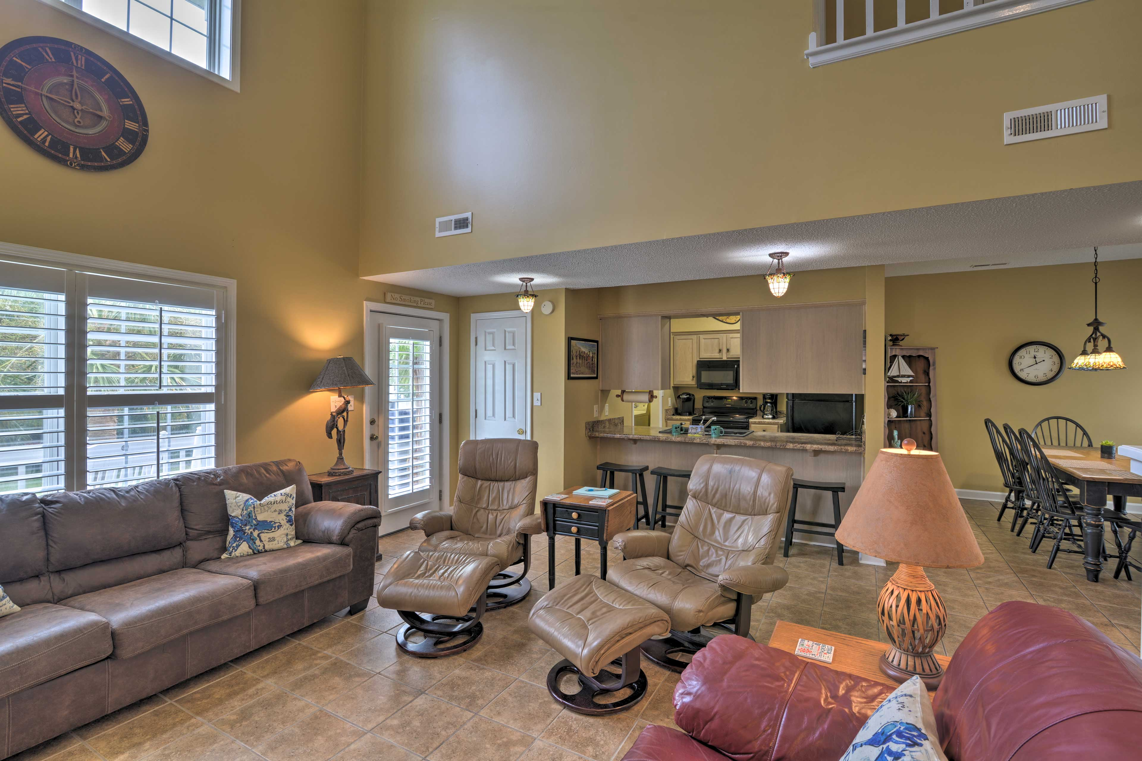 There's a seat for everyone in this spacious living area.