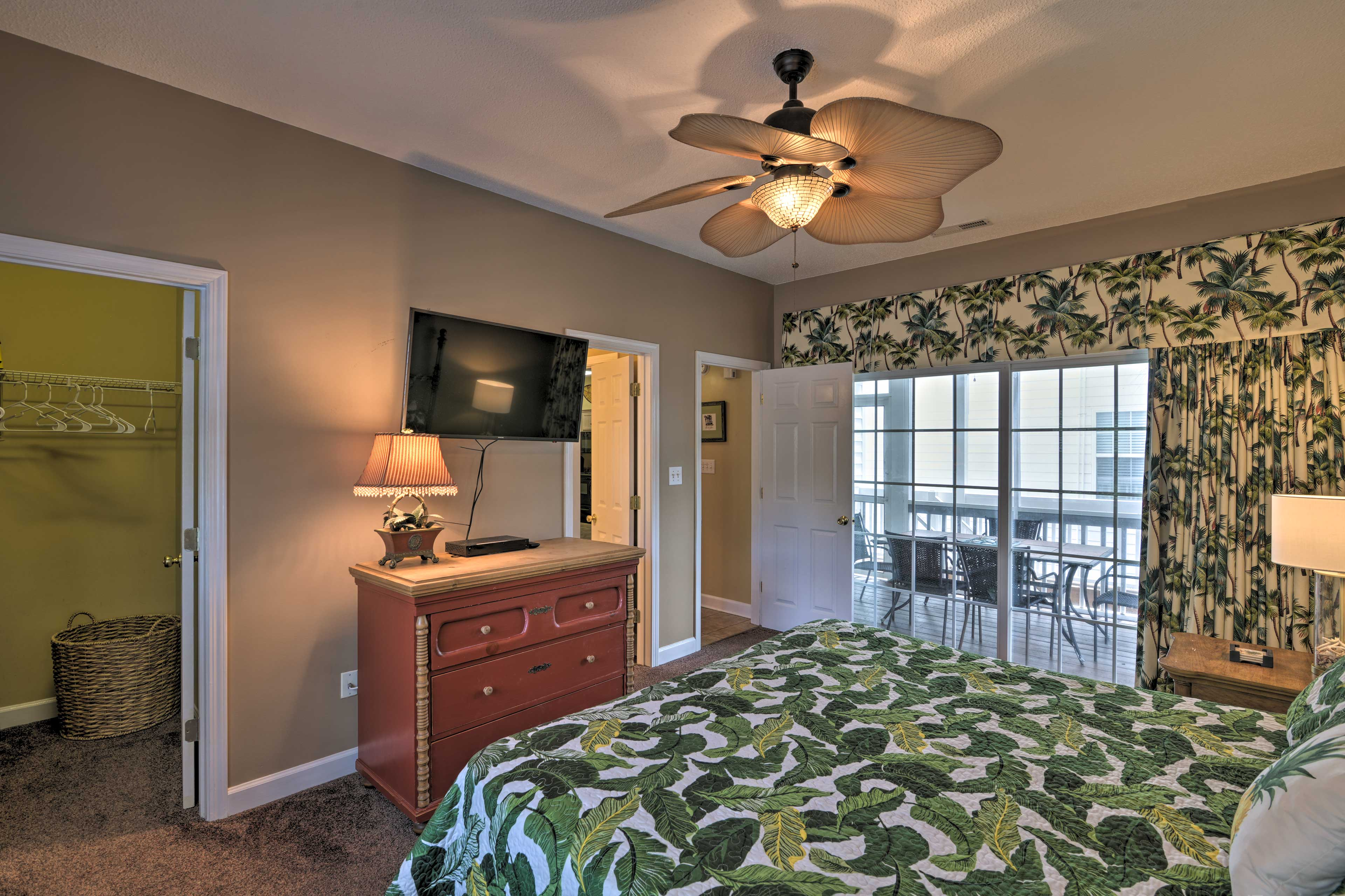 The master bedroom features its own flat-screen TV and direct deck access.
