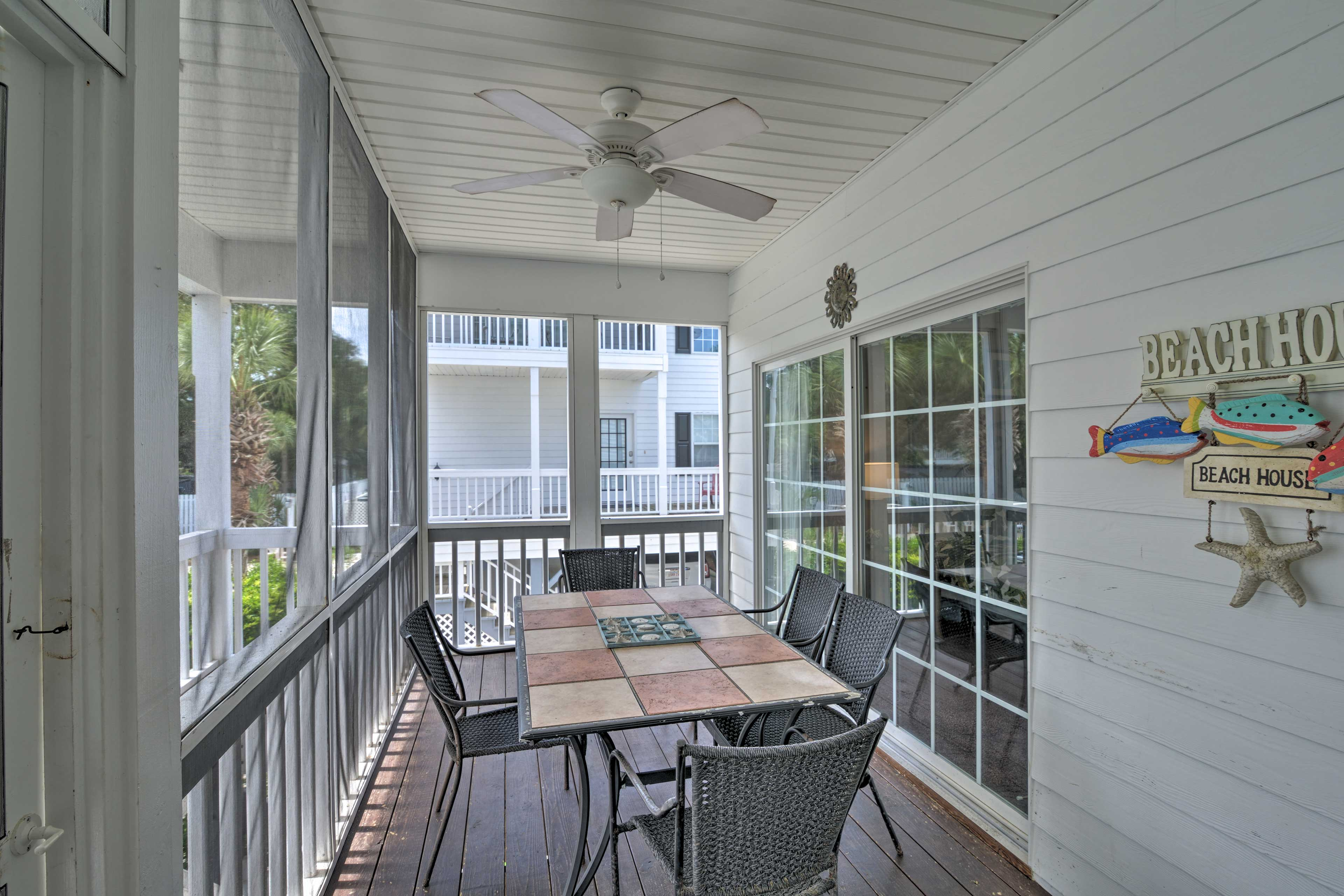 Feast al fresco in the comfort of the screened porch.