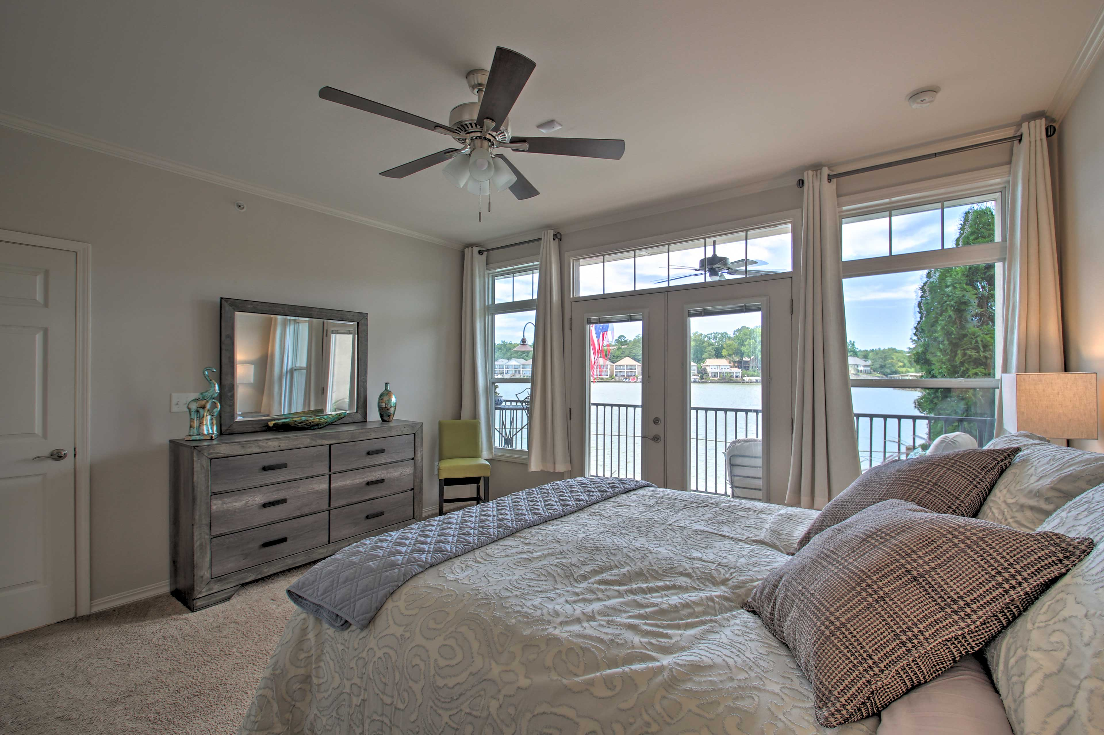 The master bedroom has a queen bed, en-suite bathroom and balcony access.