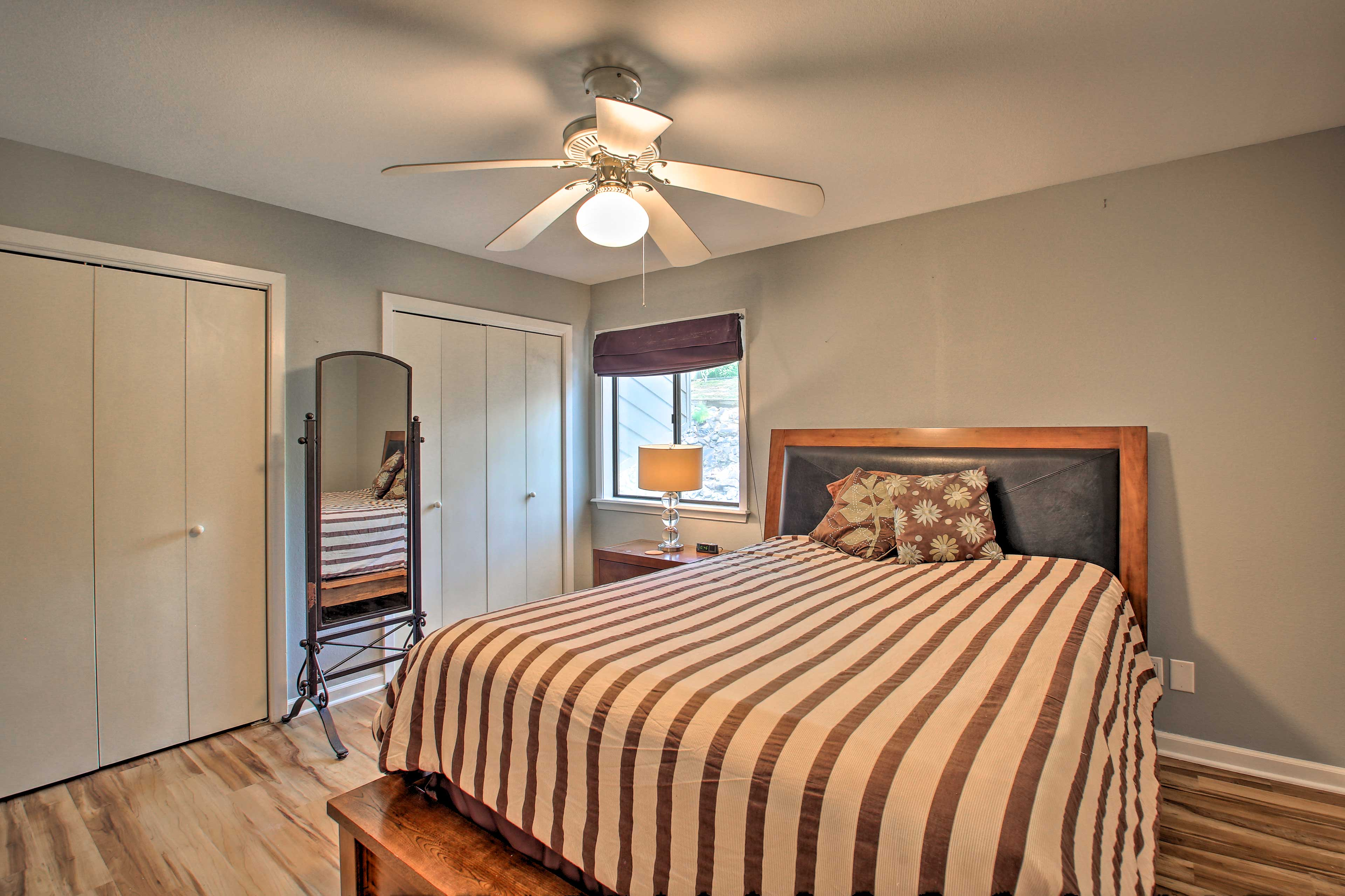 The second room is equipped with a queen bed.