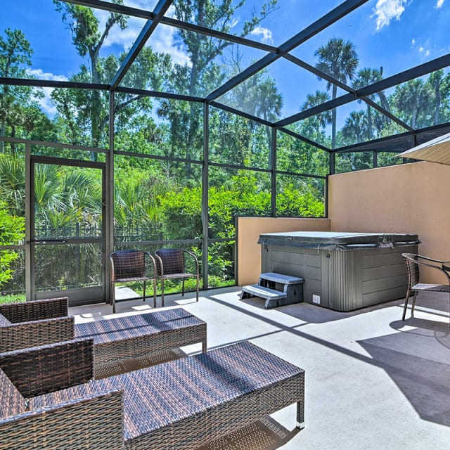 Hot tub and patio furniture on screened porch in Orlando, Florida vacation rental