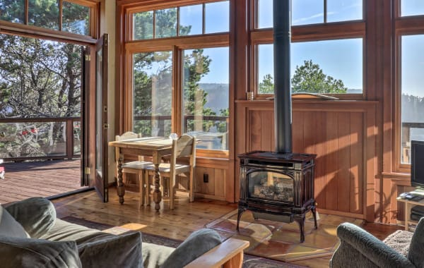 Treehouse tiny home vacation rental with glass windows and fire in Albion, CA