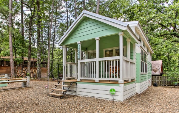 Mint green tiny house vacation rental cabin in Broken Bow forest
