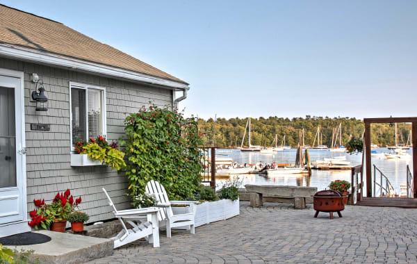 Tiny house for rent on a bay filled with boats in Freeport, ME